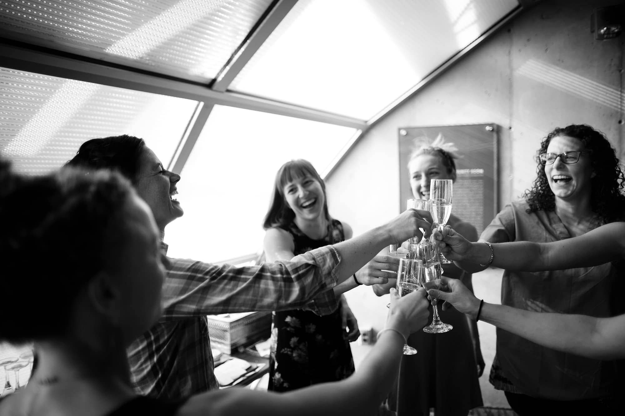 The bridal party toasts before the wedding at the museum