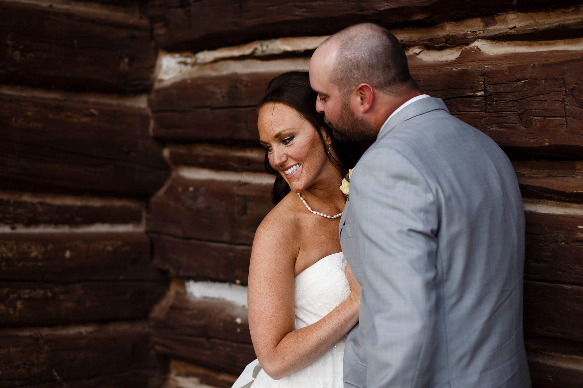 Franks kisses Heidi next to a cabin atop Boreas Pass during their wedding near Breckenridge