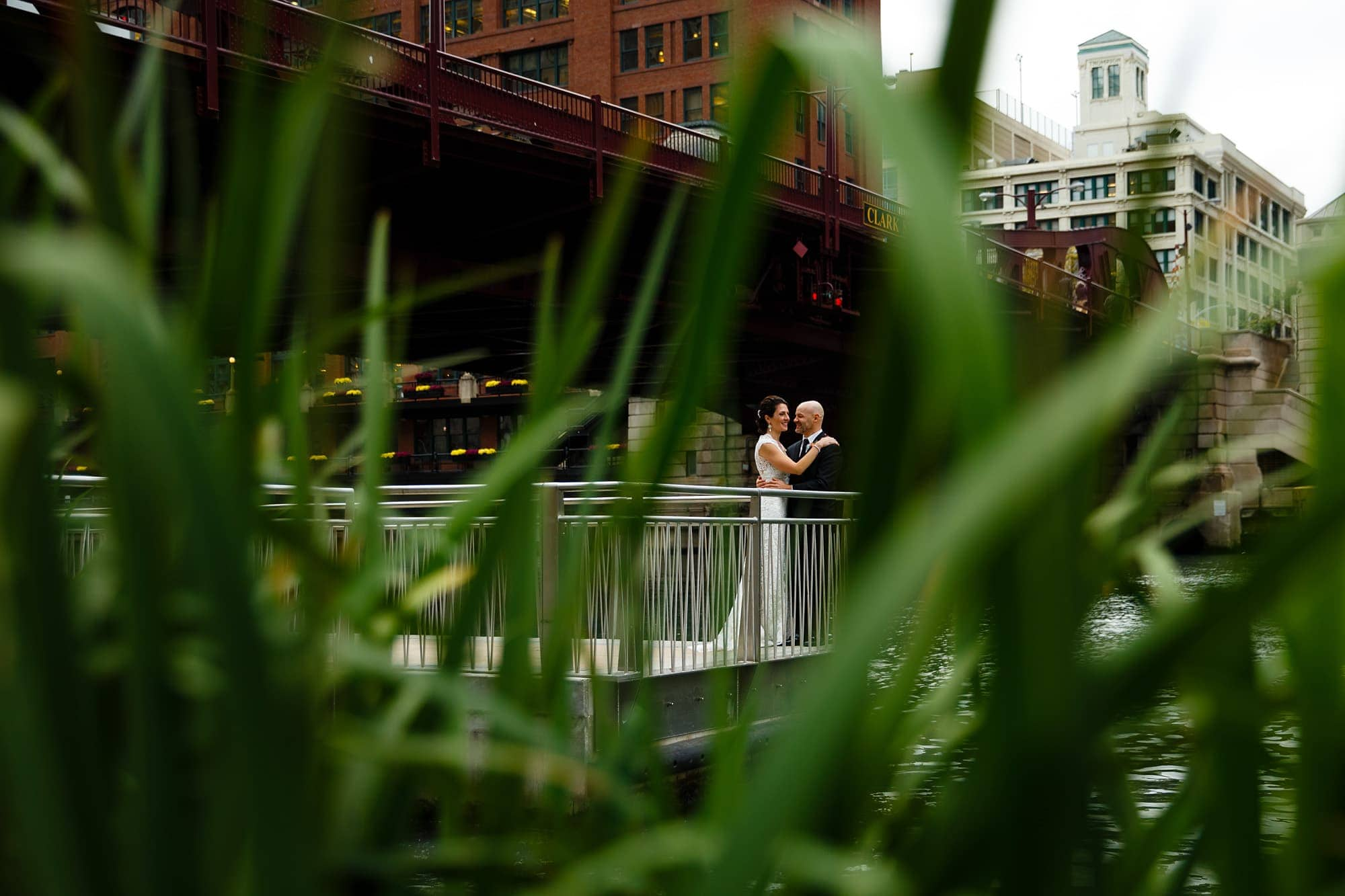 Christina and Brad share a moment together on their wedding day on the river walk under the Clark Street bridge