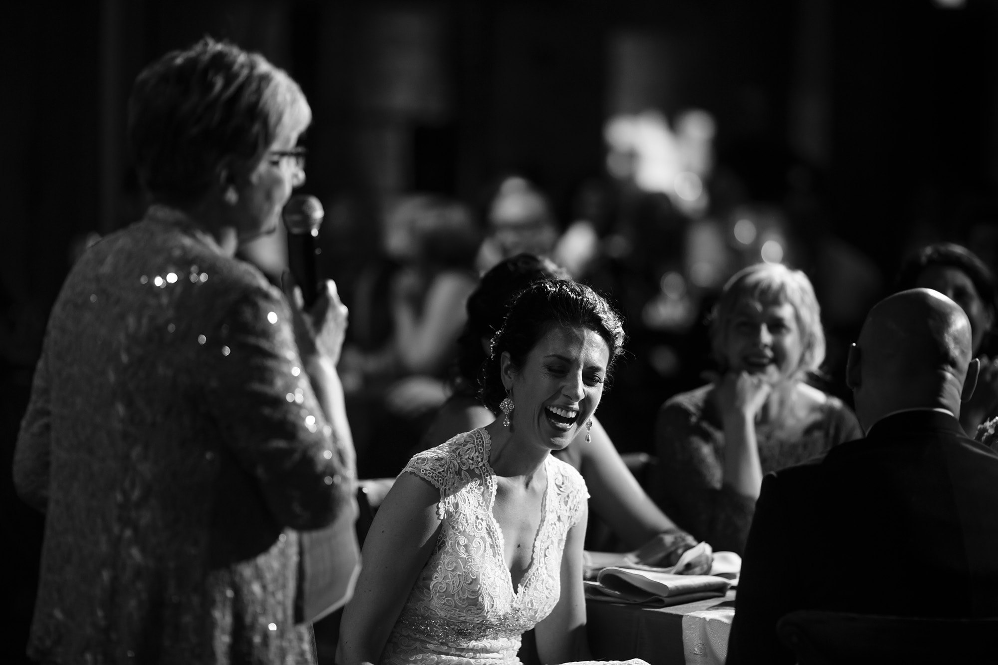Christina laughs as her mother give a speech during her Bridgeport Art Center Wedding