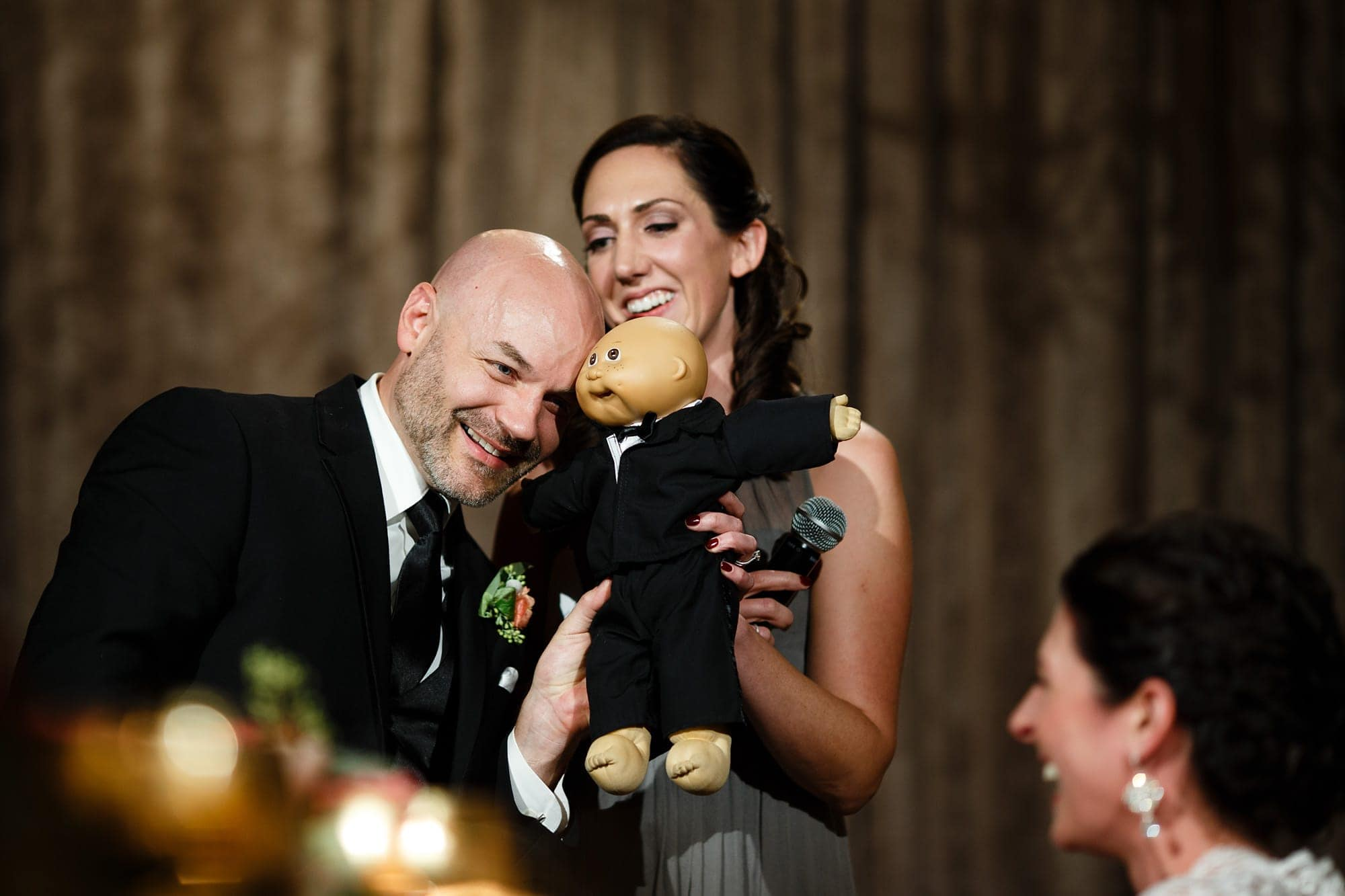 Brad aknowledges his resembelance to a cabbage patch doll as Christina's sister gives a speech during their Bridgeport Art Center wedding