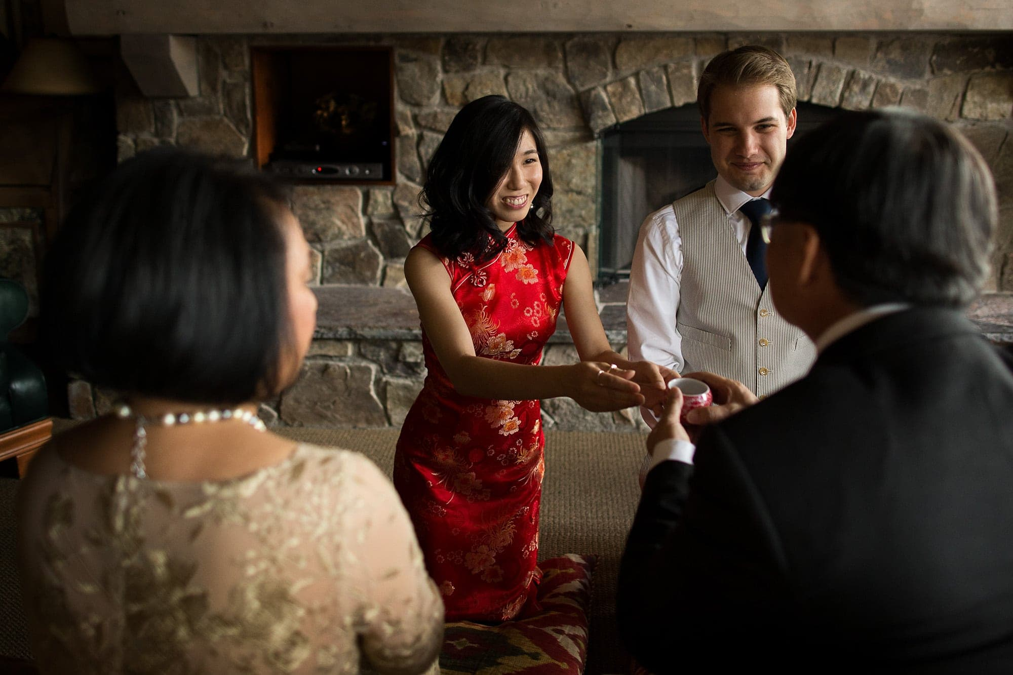 Allison presents her father with tea during a traditional Chinese tea ceremony before the wedding