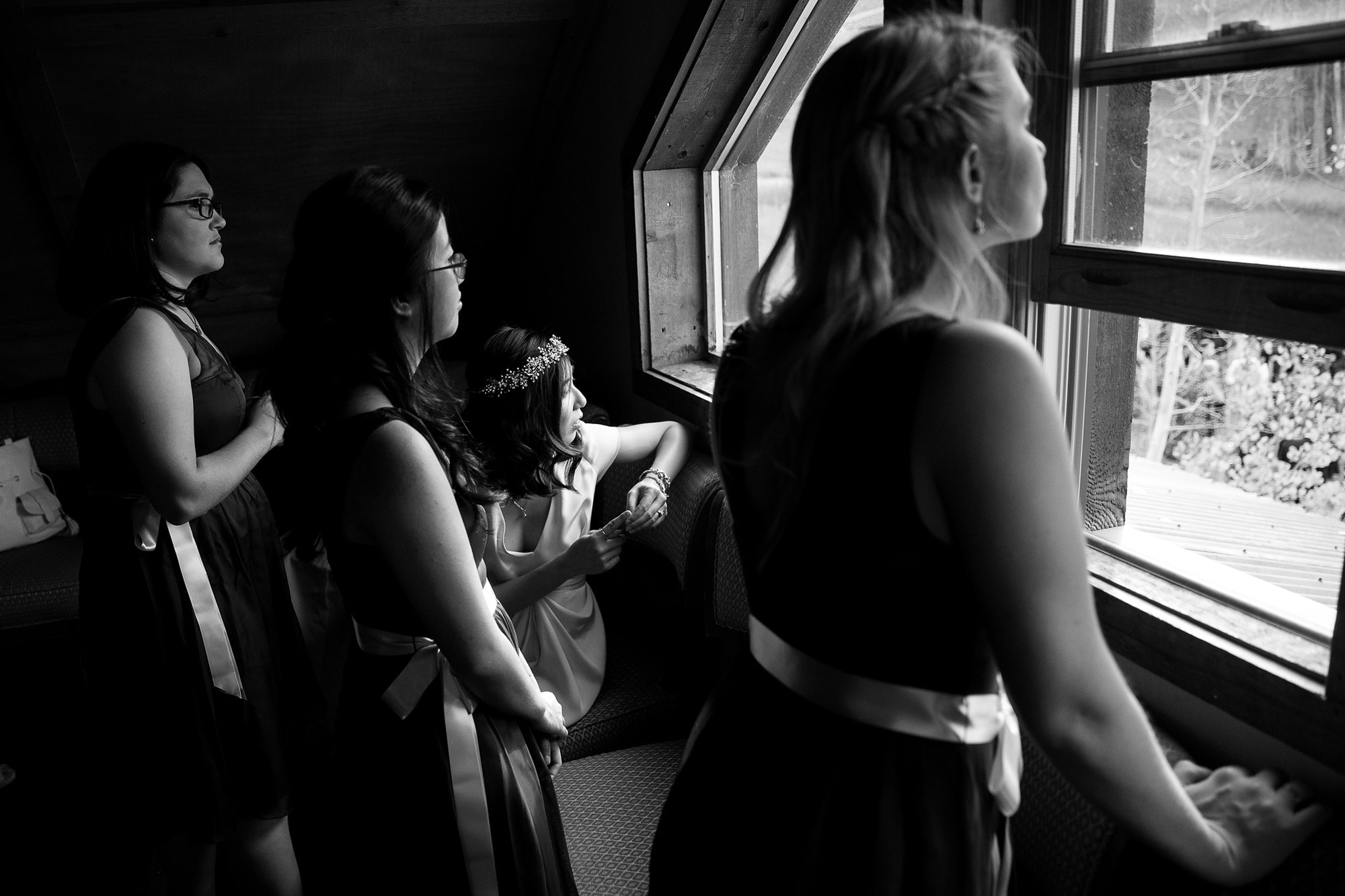 The girls peek out the window at Lynn Britt Cabin before the wedding ceremony starts