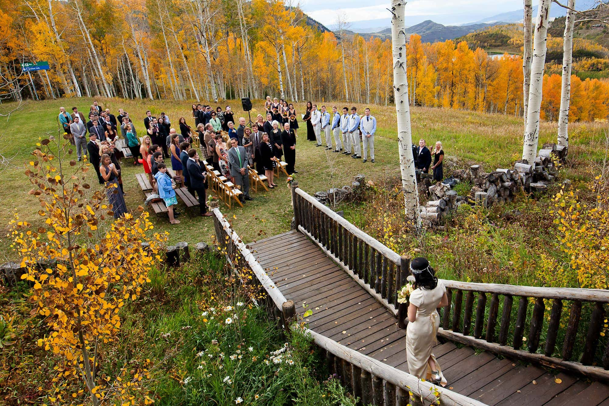 Bride Allison walks out of the cabin during her and Walker's Lynn Britt Cabin wedding in Snowmass Village near Aspen, Colorado.