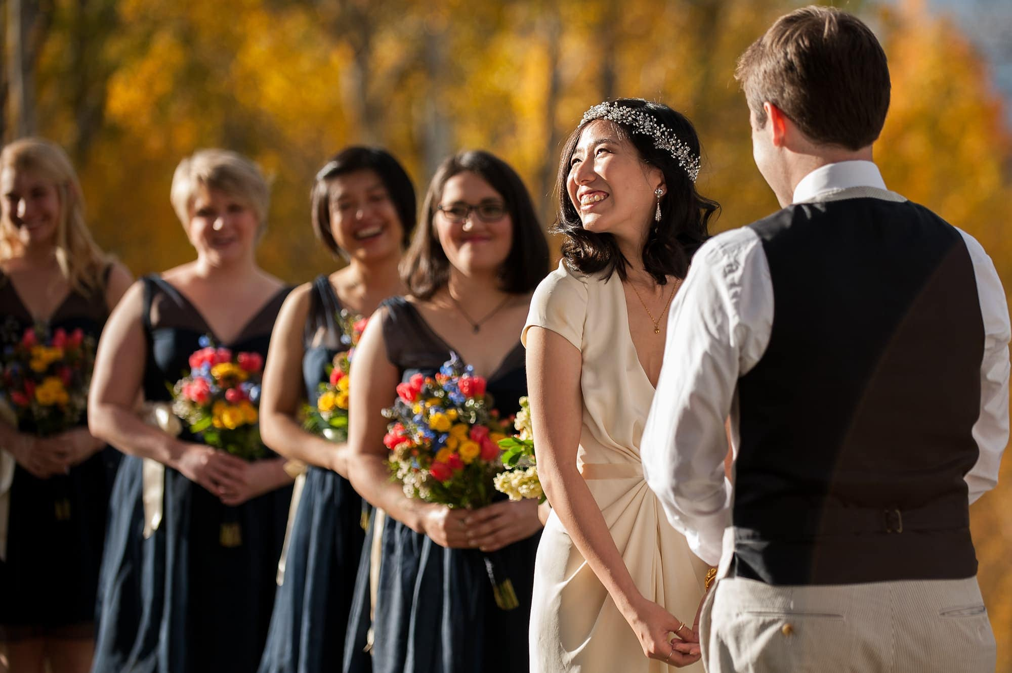 Allison smiles during her wedding to Walker at Lynn Britt Cabin in Snowmass Village near Aspen, Colorado.