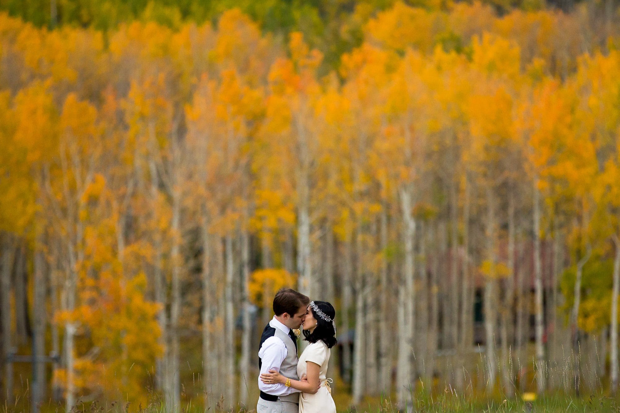Walker kisses Allison near Lynn Britt Cabin in Snowmass Village near Aspen, Colorado.