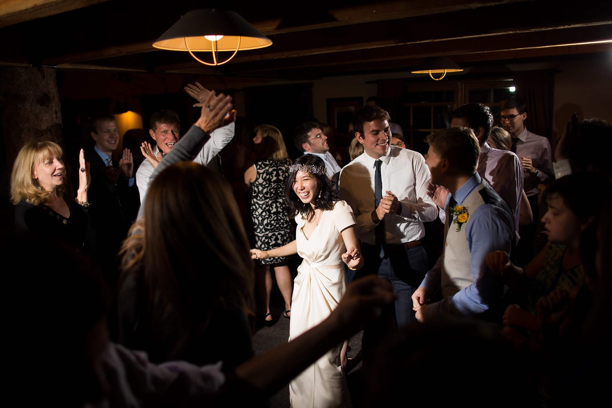 Guests dance during Allison and Walker's Lynn Britt Cabin wedding in Snowmass Village near Aspen, Colorado.