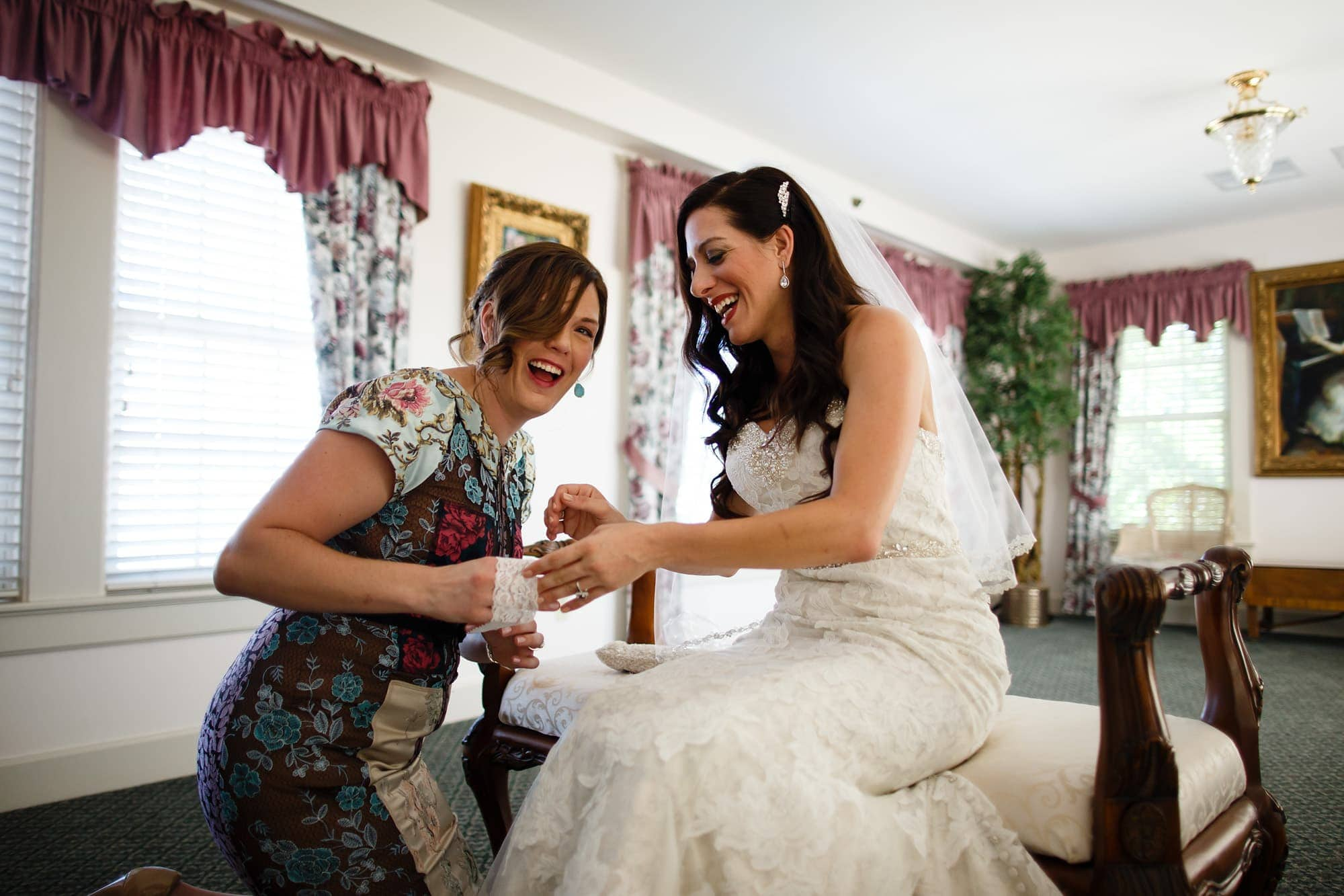 Gina get ready for her Willow Ridge Manor wedding with a friend in the bridal prep room