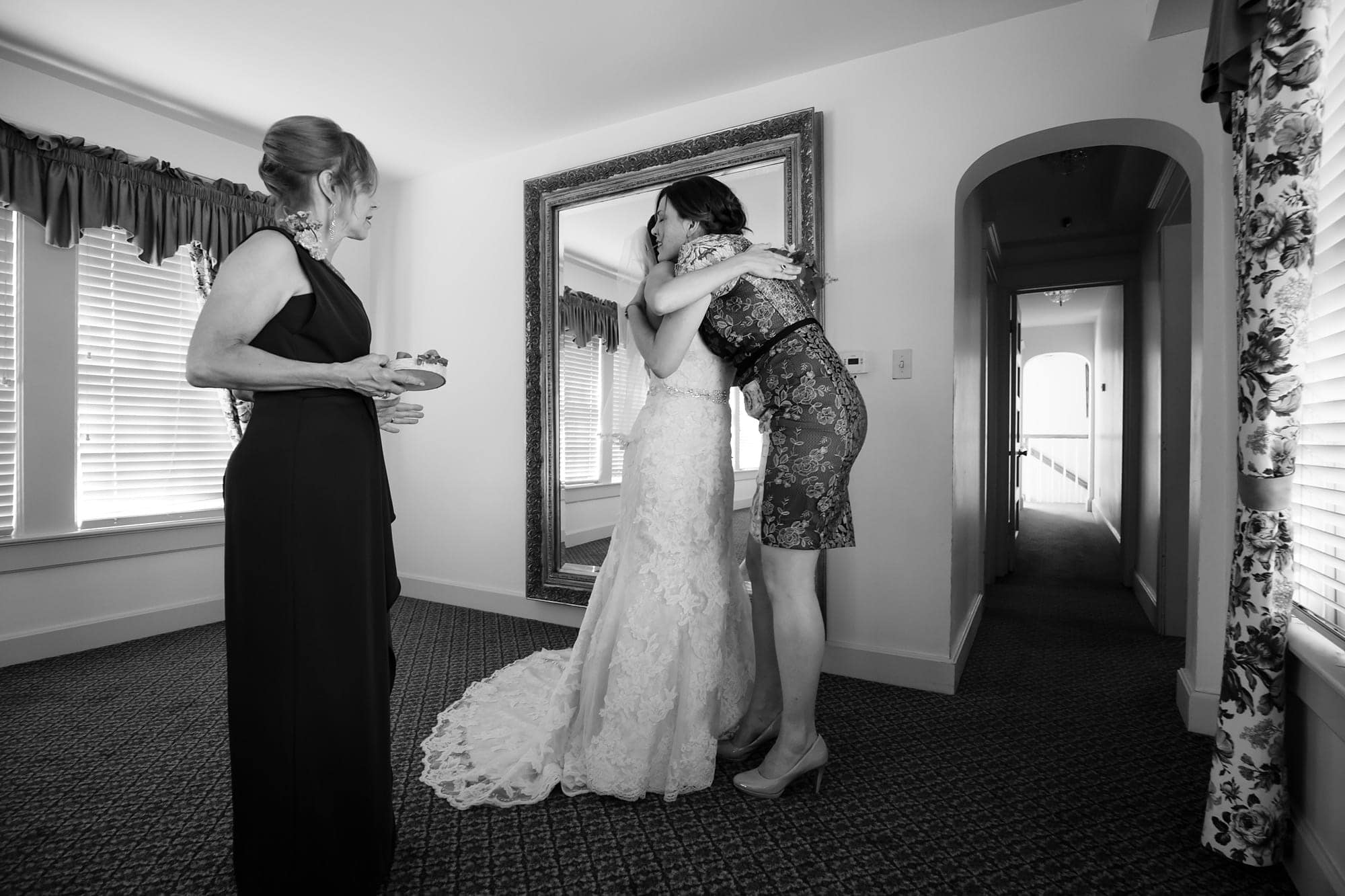 Gina hugs a friend in the bridal room before her wedding with Blake