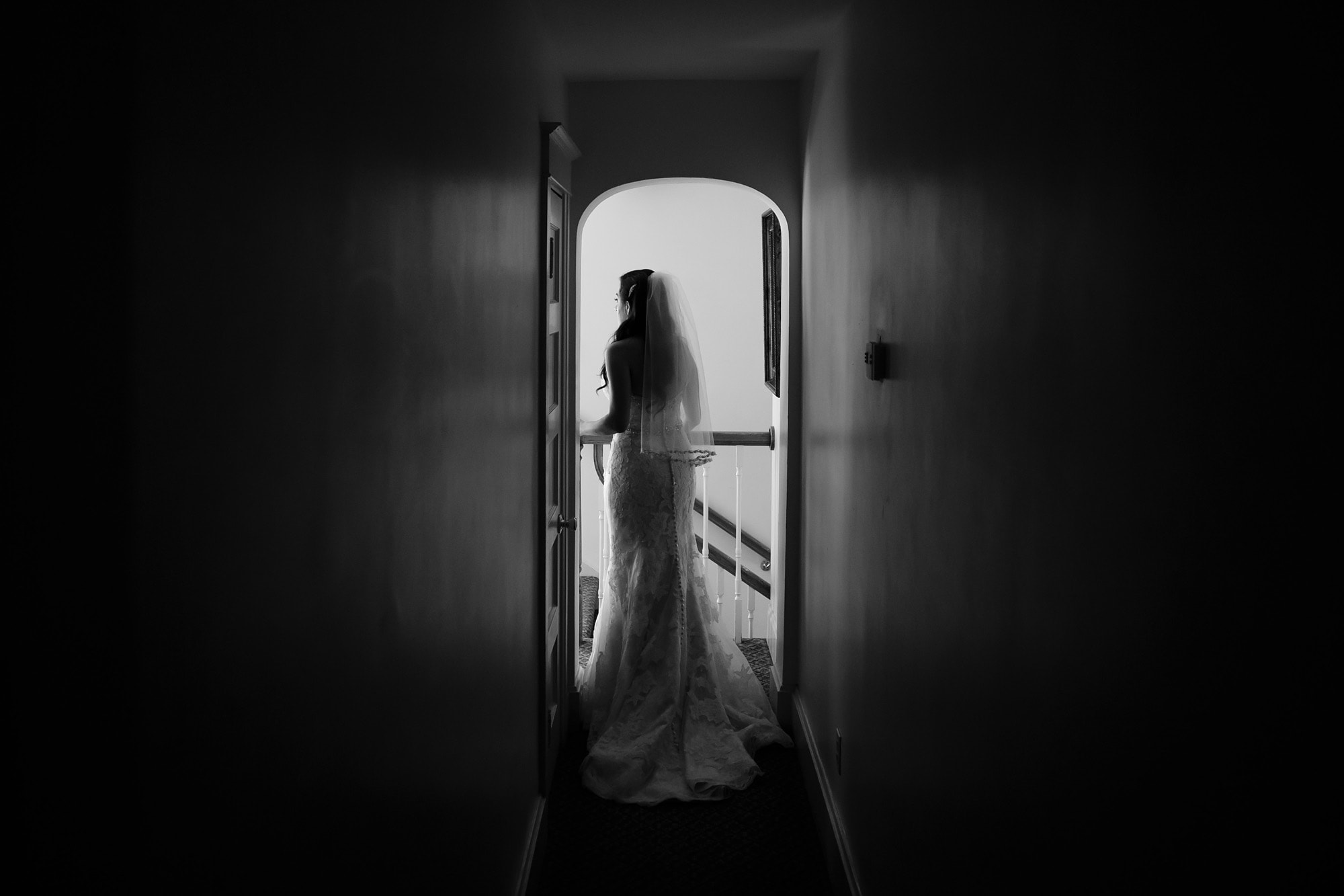 Gina walks down the hallway before her wedding