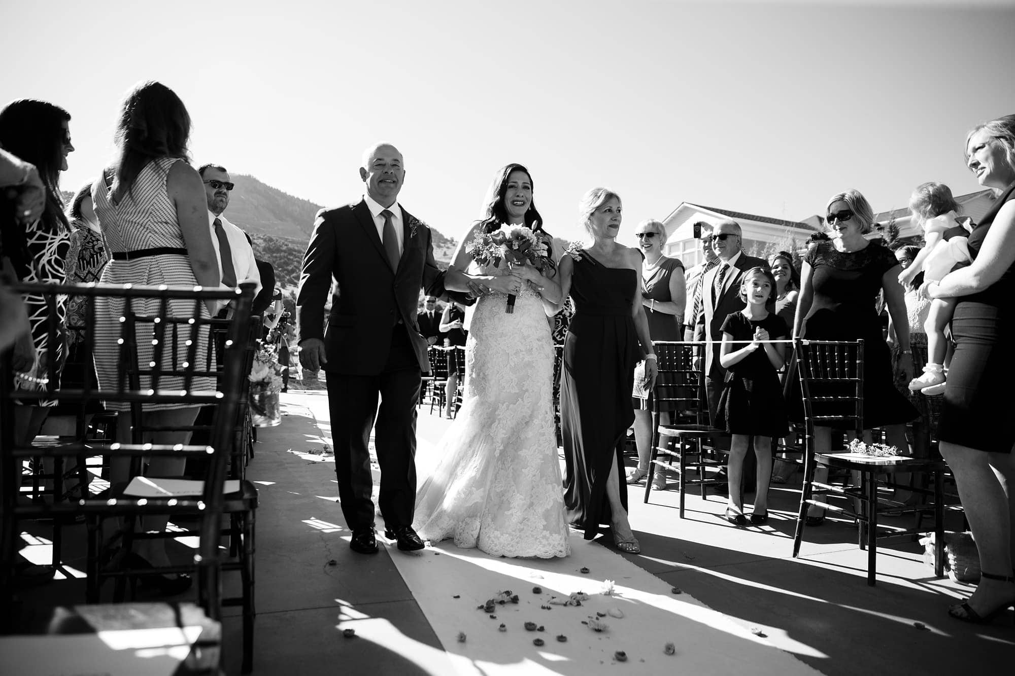 Gina cries as she walks down the aisle during her Willow Ridge Manor wedding