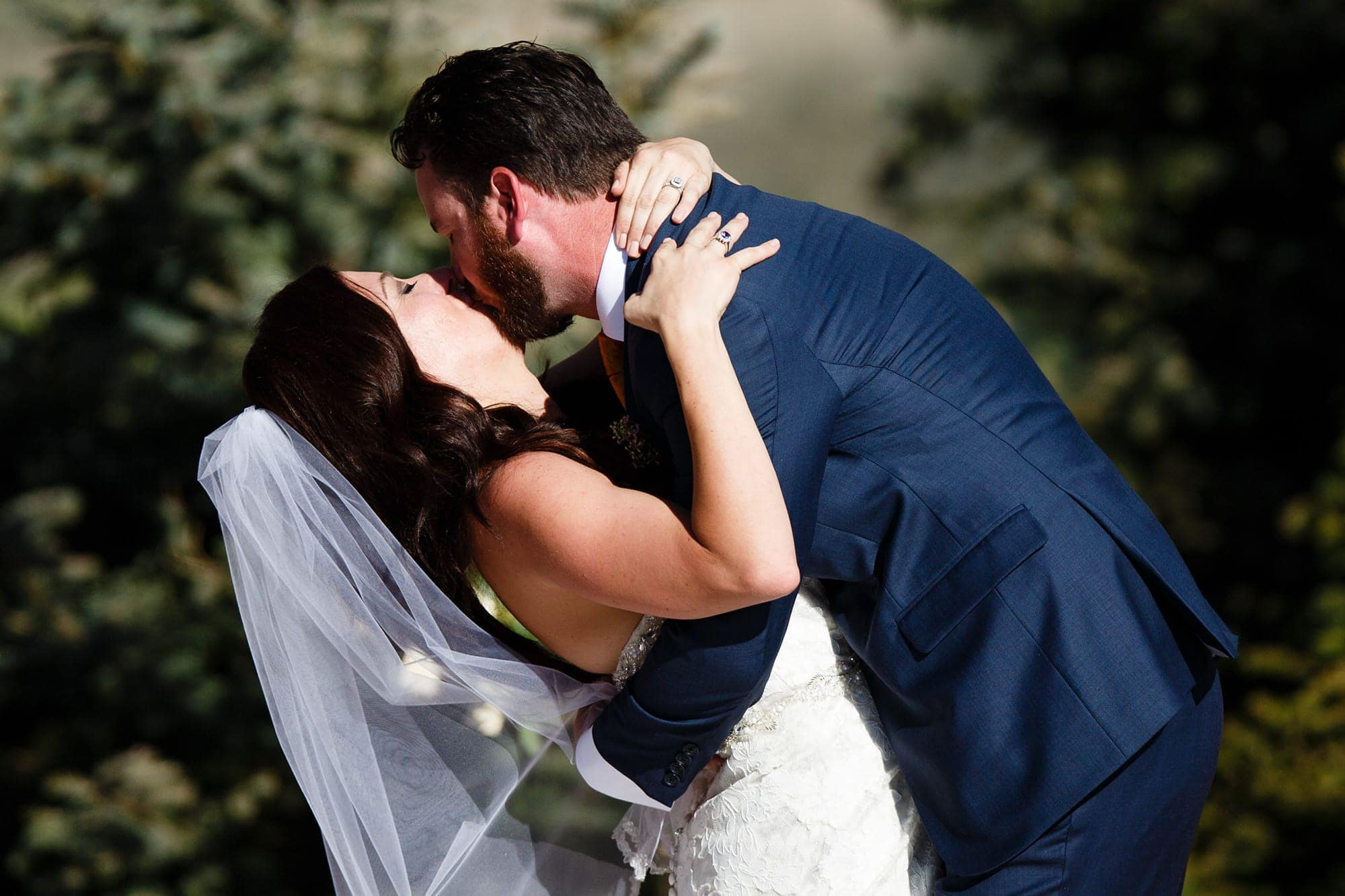 Blake and Gina share a first kiss during the ceremony