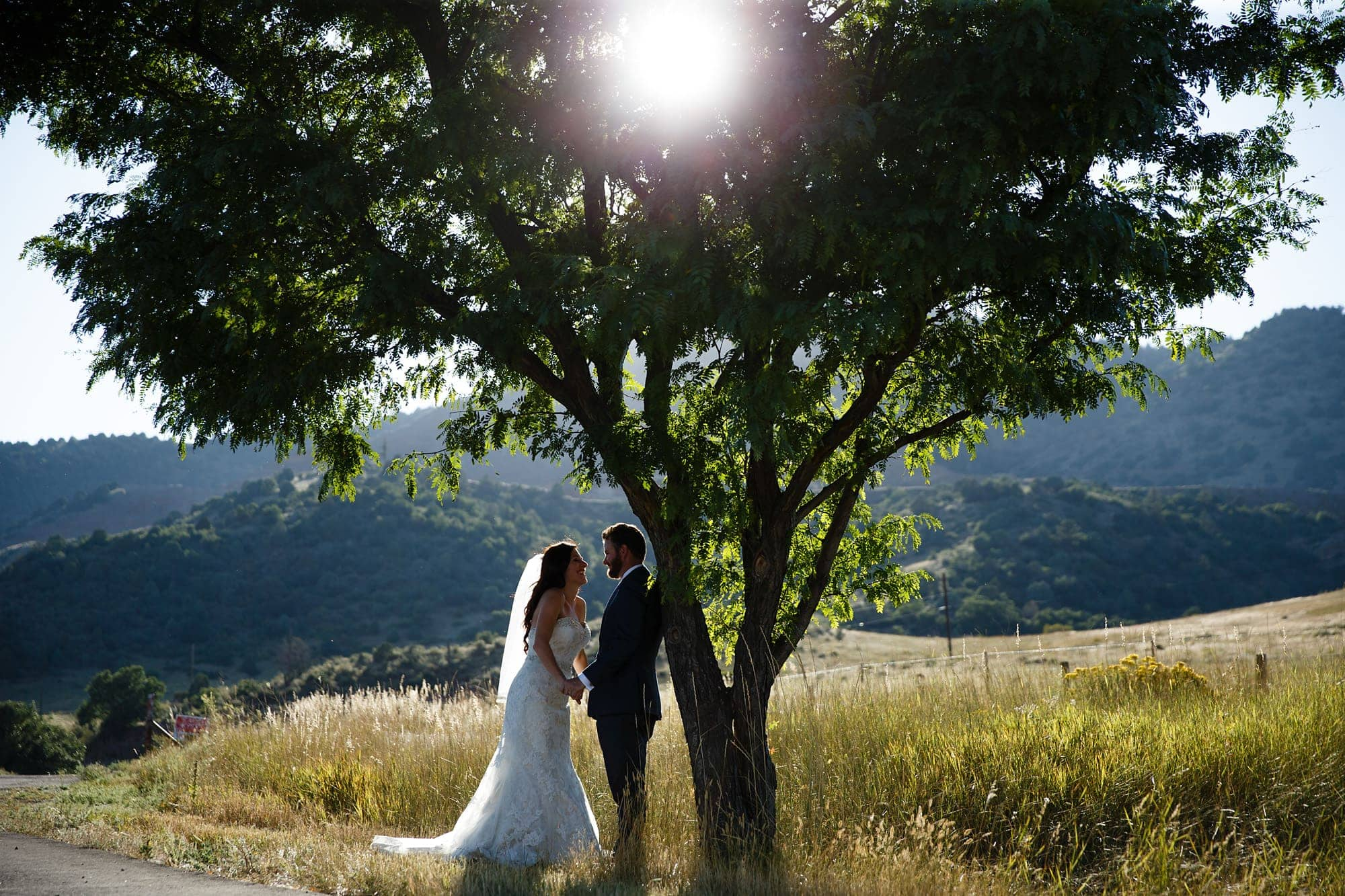 Blake and Gina share a moment together after their wedding under a tree in Morrison, Colorado