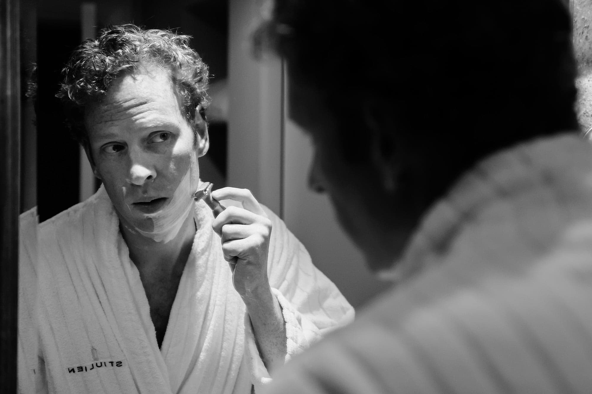 Groom shaves at the St. Julien hotel before his nuptials