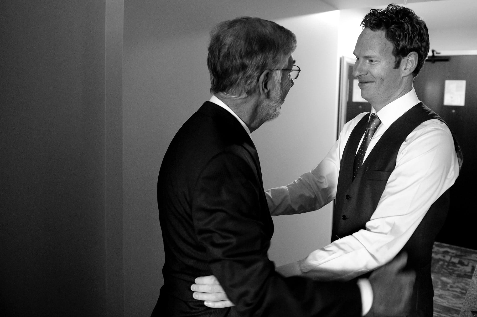 The groom and his father share a moment before leaving the hotel