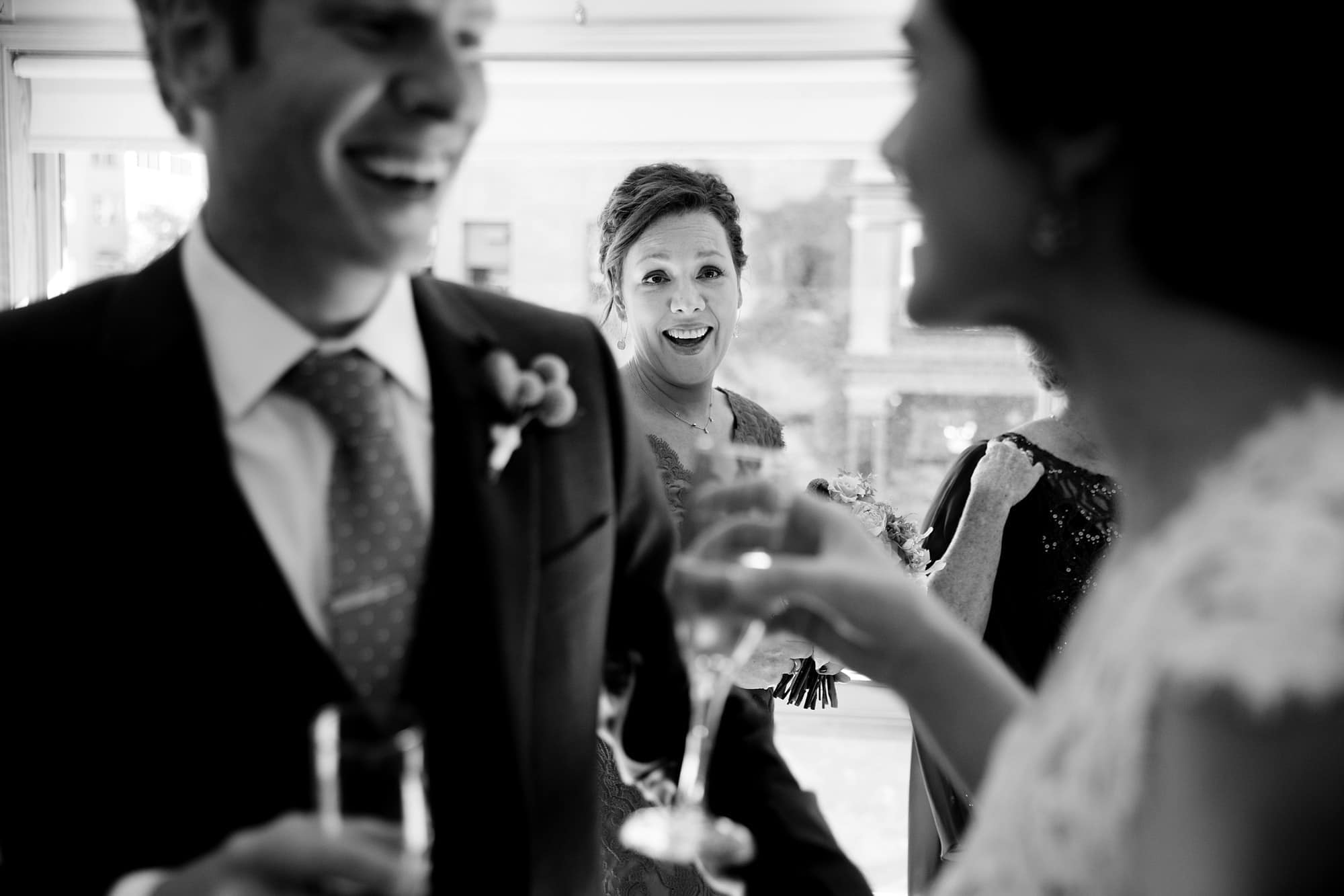 The sister of the groom laughs after the ceremony