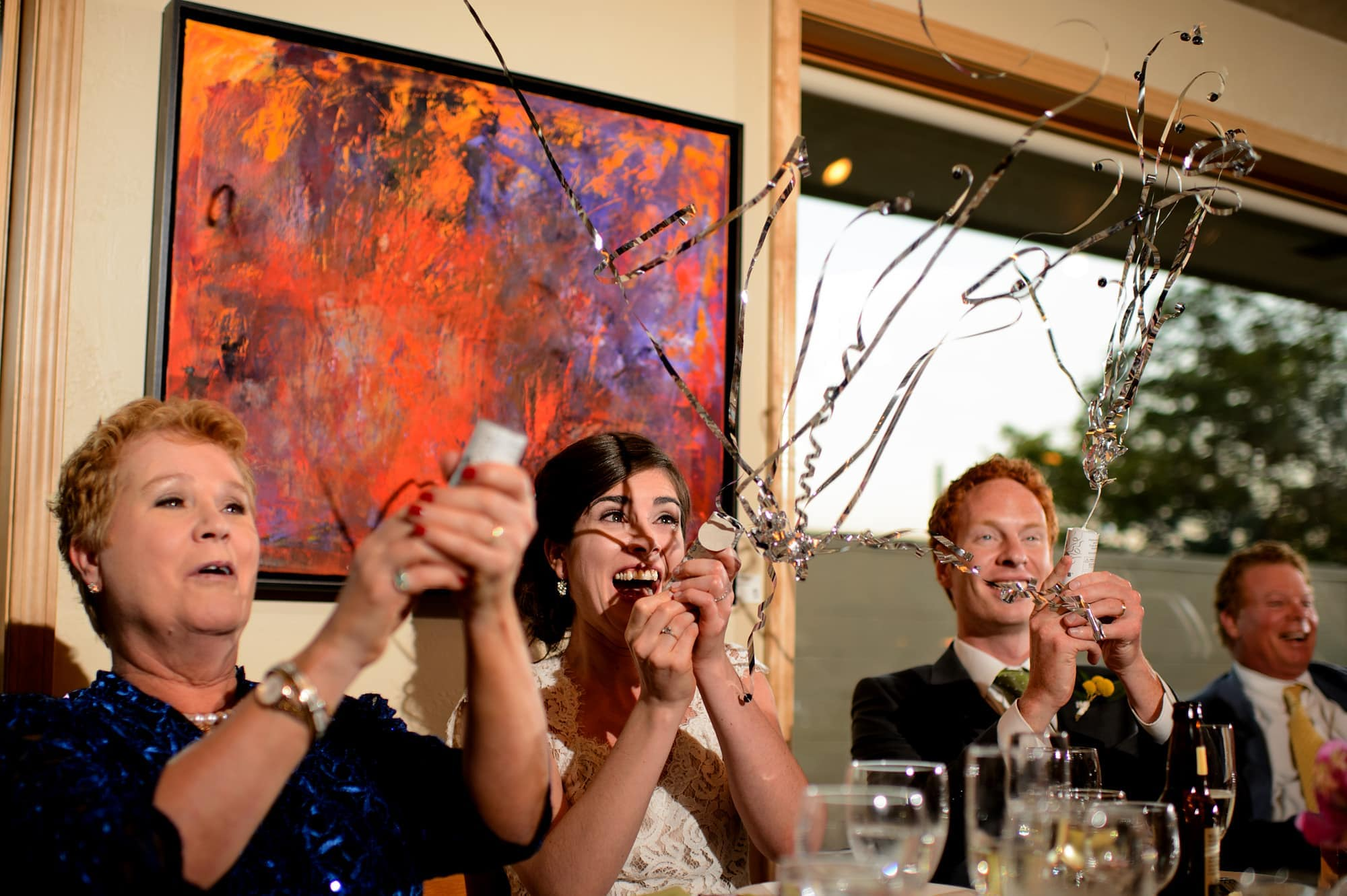 Streamers fly during toasts at the wedding reception in Boulder