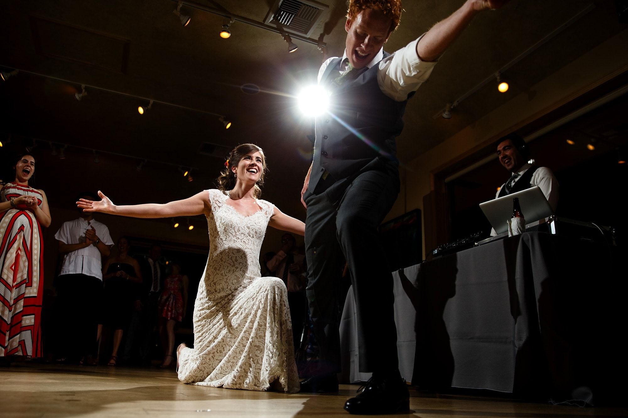 The bride dances with the groom at Rembrandt yard during their reception in Boulder