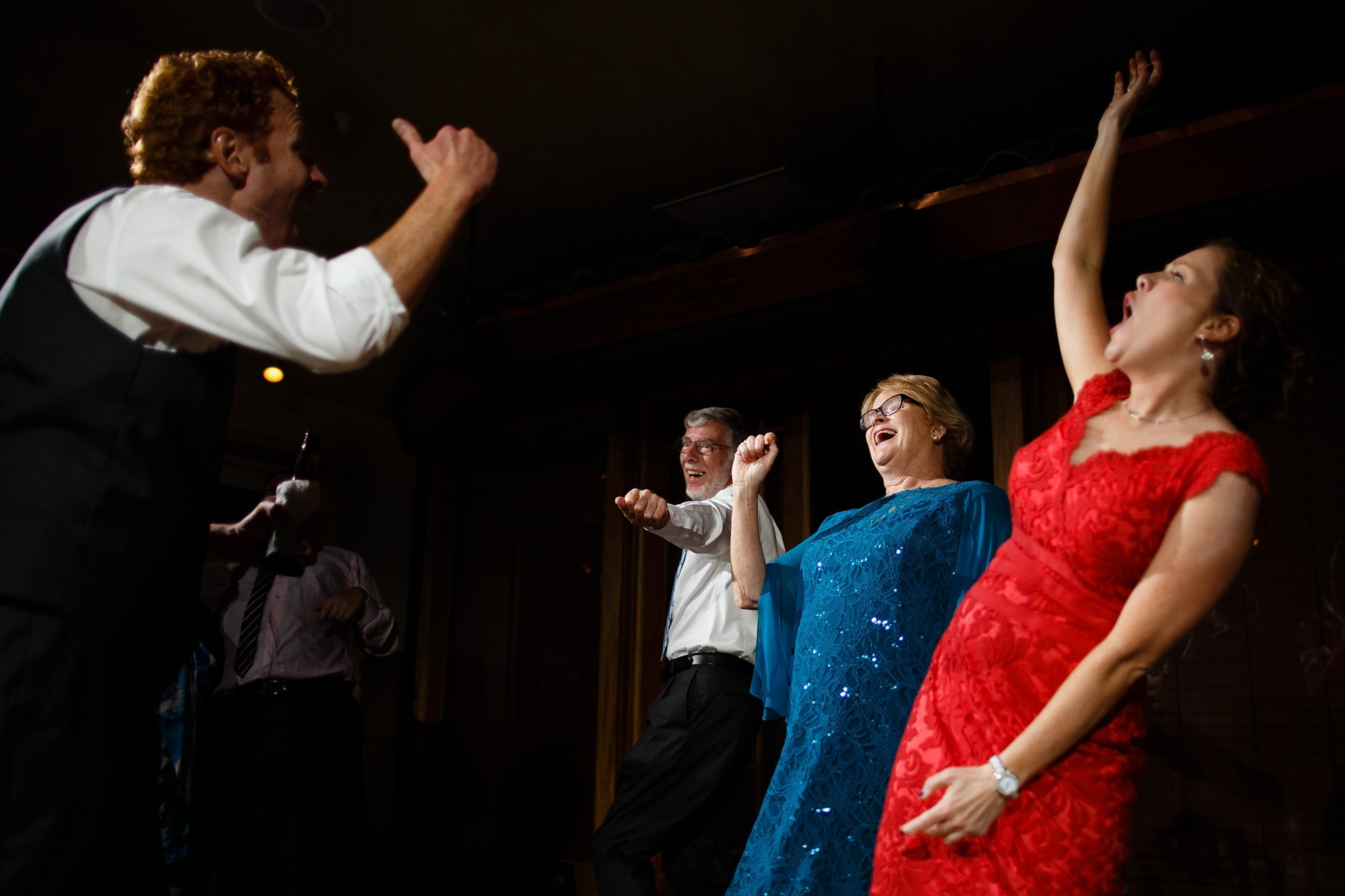 The groom dances to Bon Jovi with his family during his wedding reception at Rembrandt Yard in Boulder
