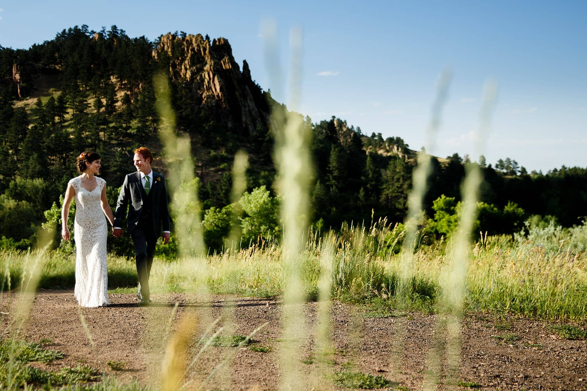 A couple walks on the trail at Centennial Trailhead in Boulder, Colorado