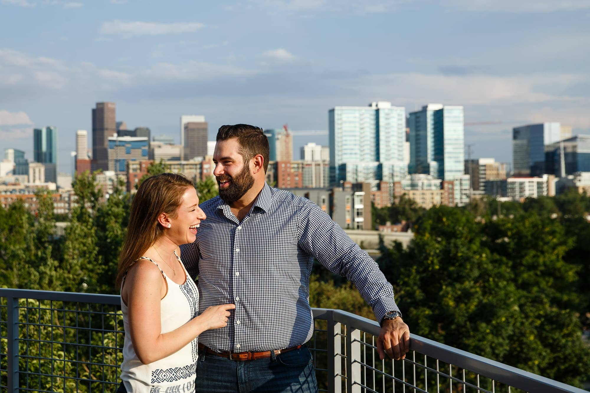 Devan and Josh share a laugh at Avanti in the LoHi neighborhood during their engagement session