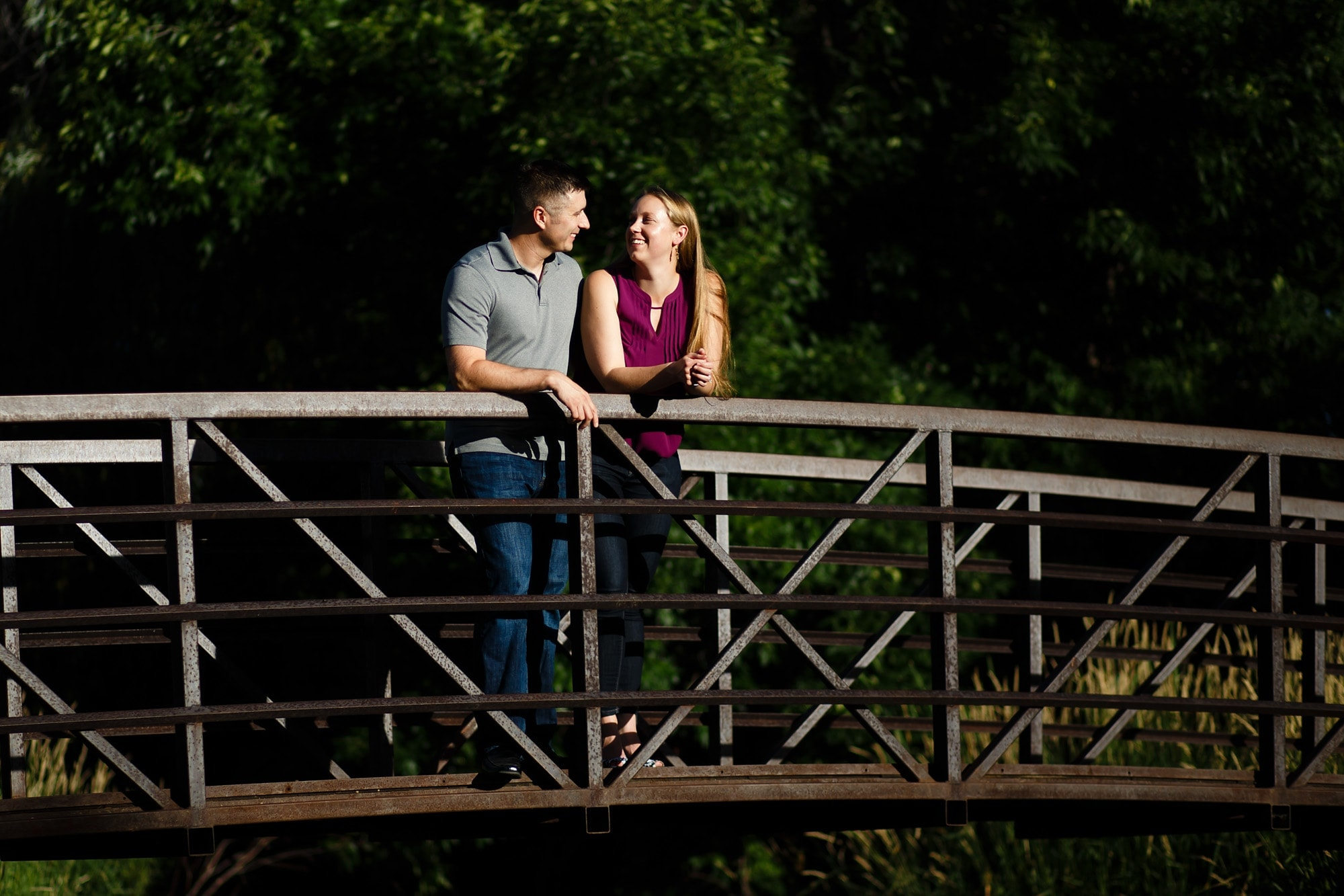 Megan and Bill share a moment at Sterne Park during their engagement session in Littleton Colorado.