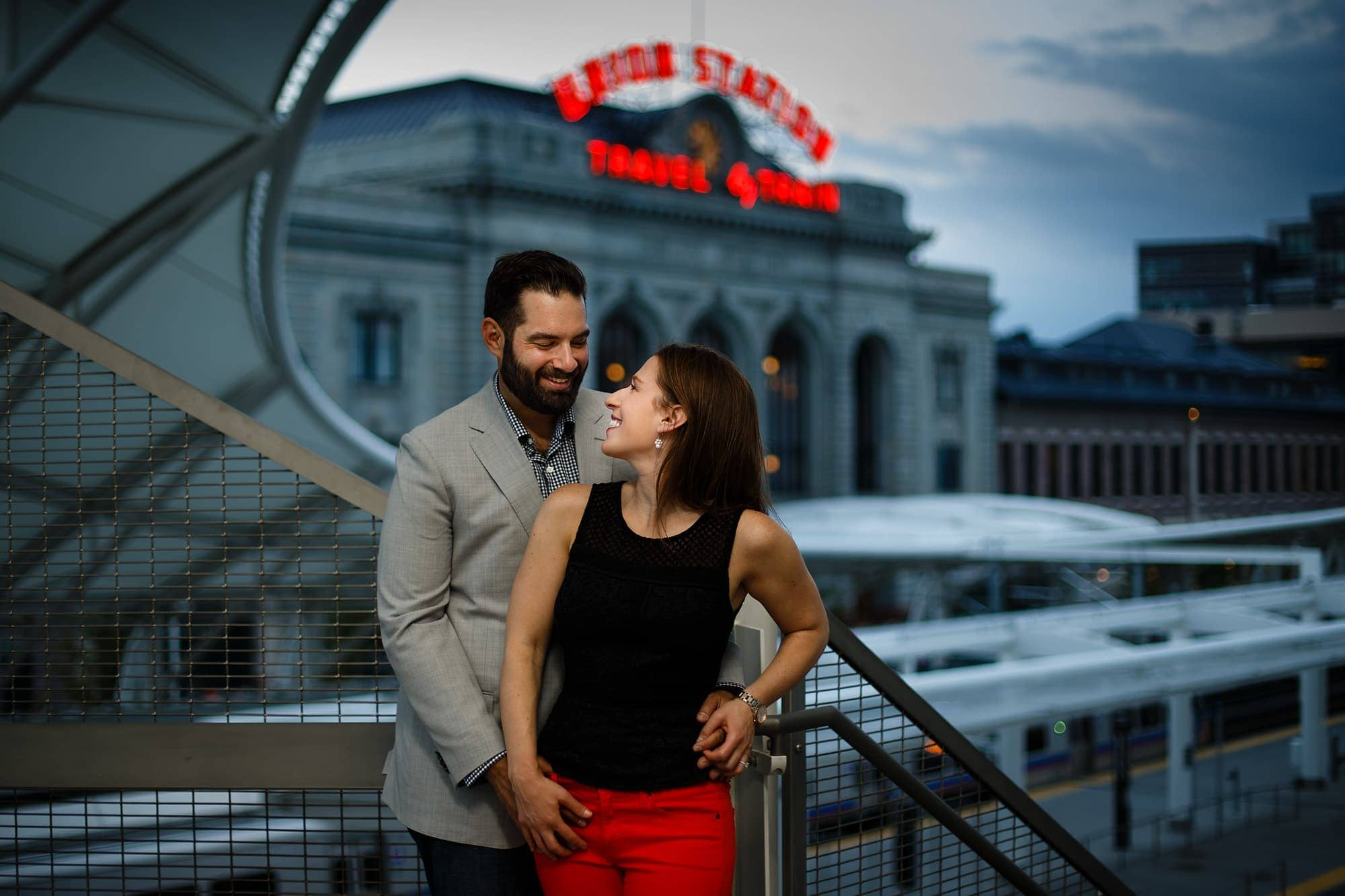 Devan and Josh are cute together at the Union Station Train Station in LoDo to celebrate their upcoming nuptials