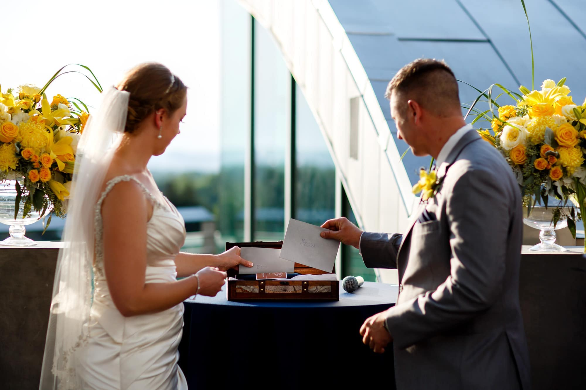 A couple exchange letters to each other during their ceremony and place them in a wine box
