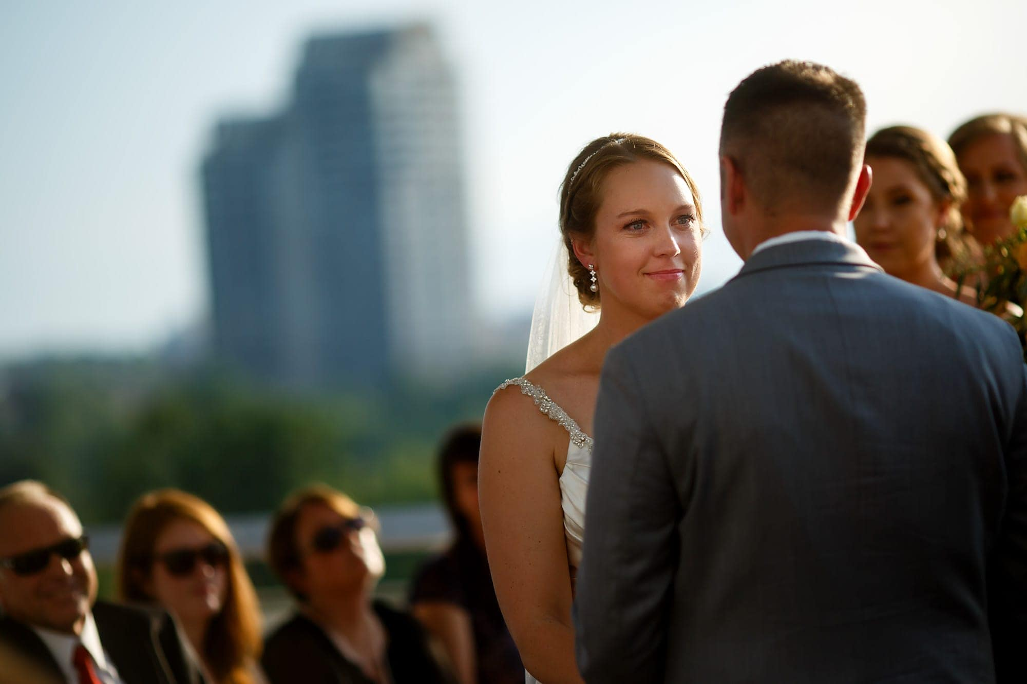 A bride stares into the eyes of her future husband during their wedding at the Denver Museum of Nature and Science