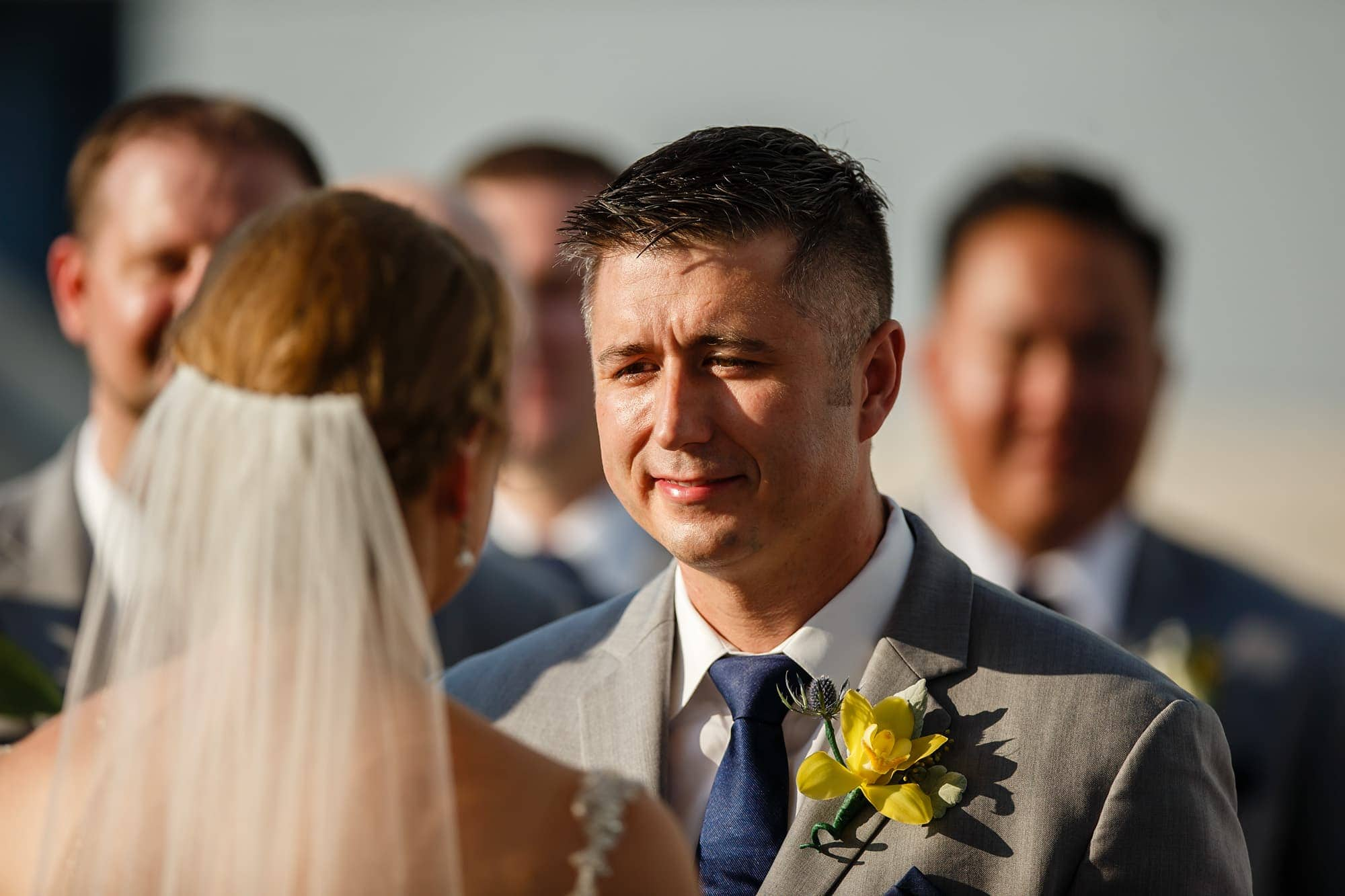 A groom looks into the brides eyes at the Denver Museum of Nature and Science