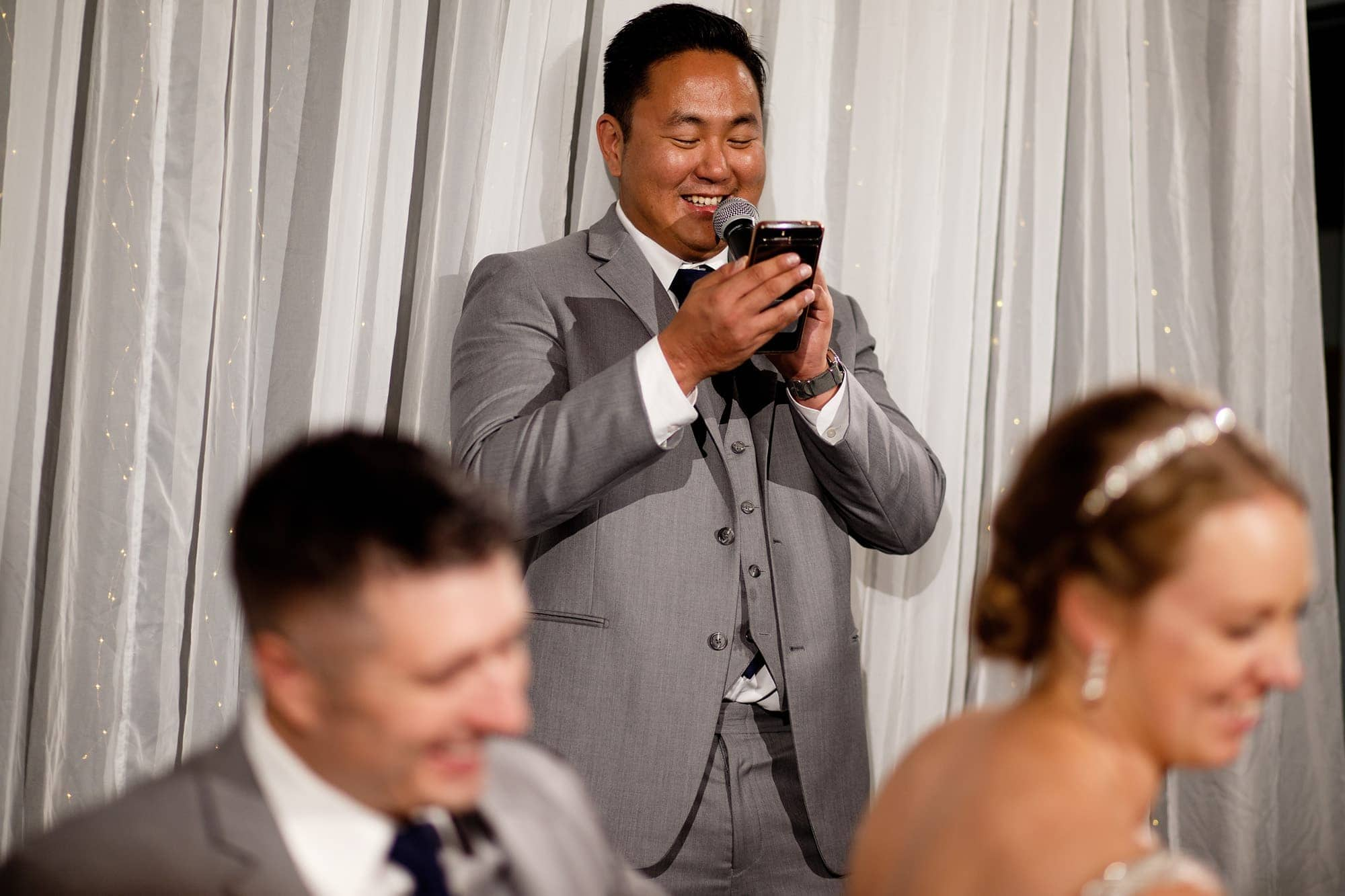 A groomsman shares a speech