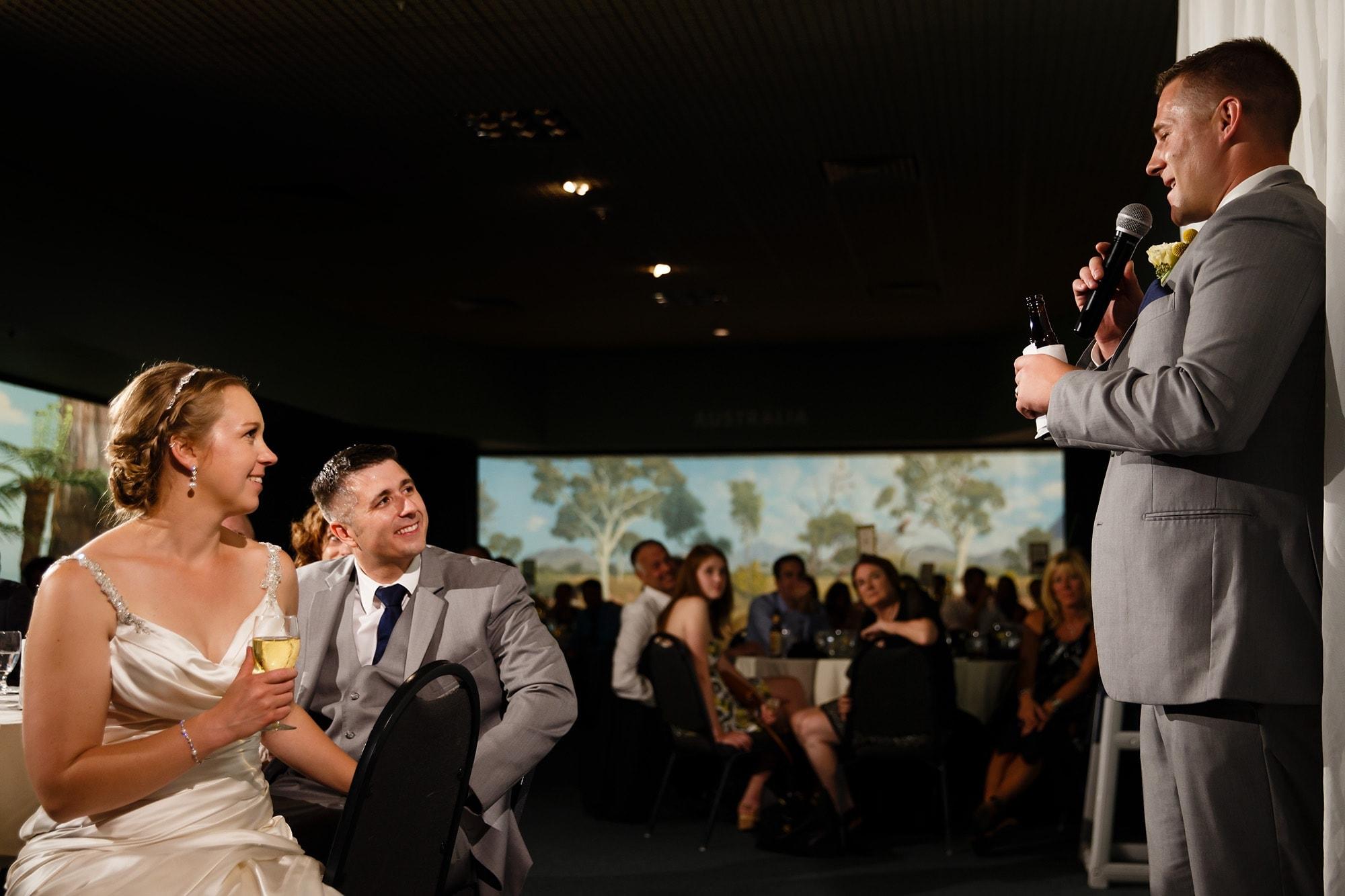 A groomsman shares a speech during dinner