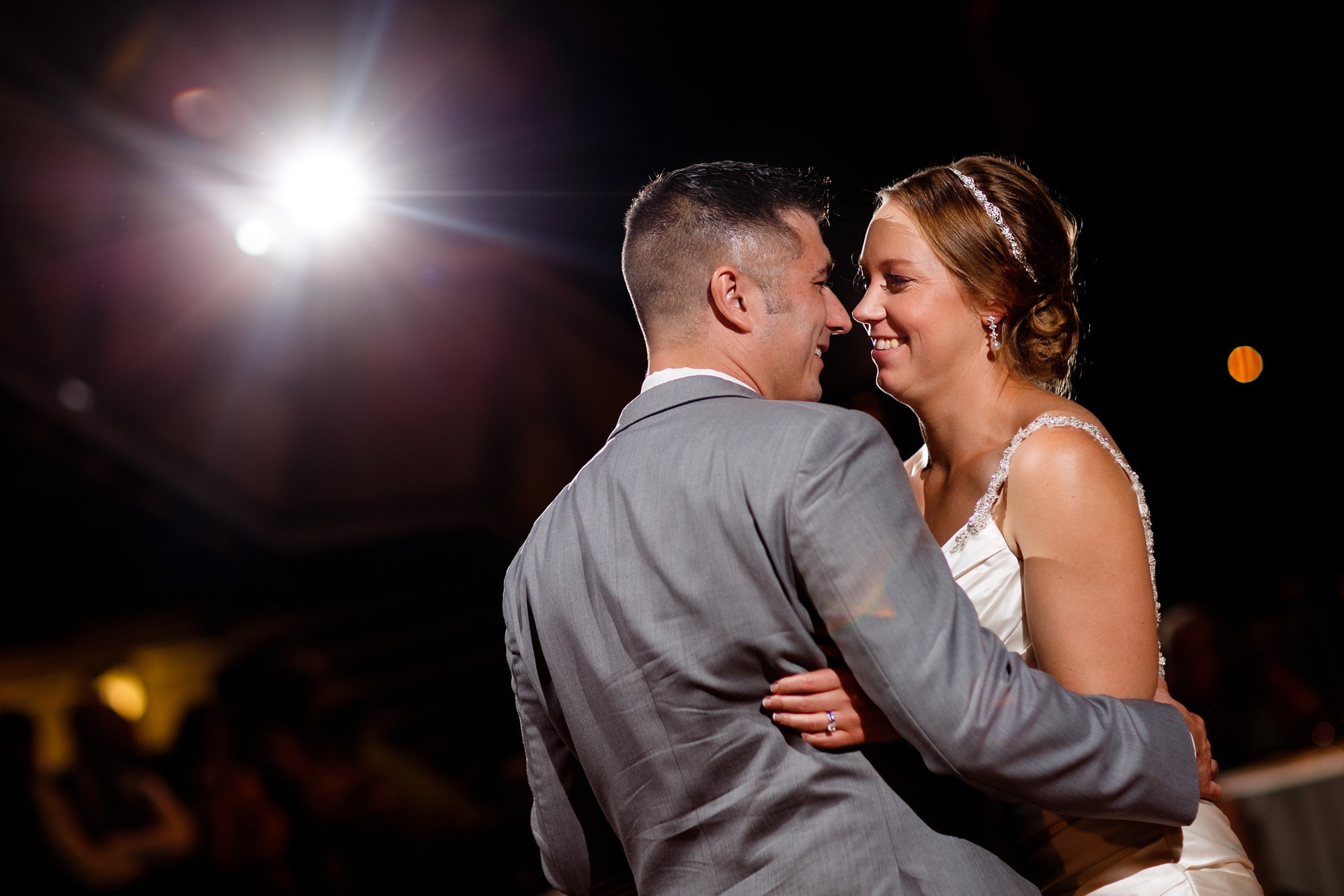 Megan and Bill share their first dance together as husband and wife during their reception in the west atrium at the Denver Museum of Nature and Science