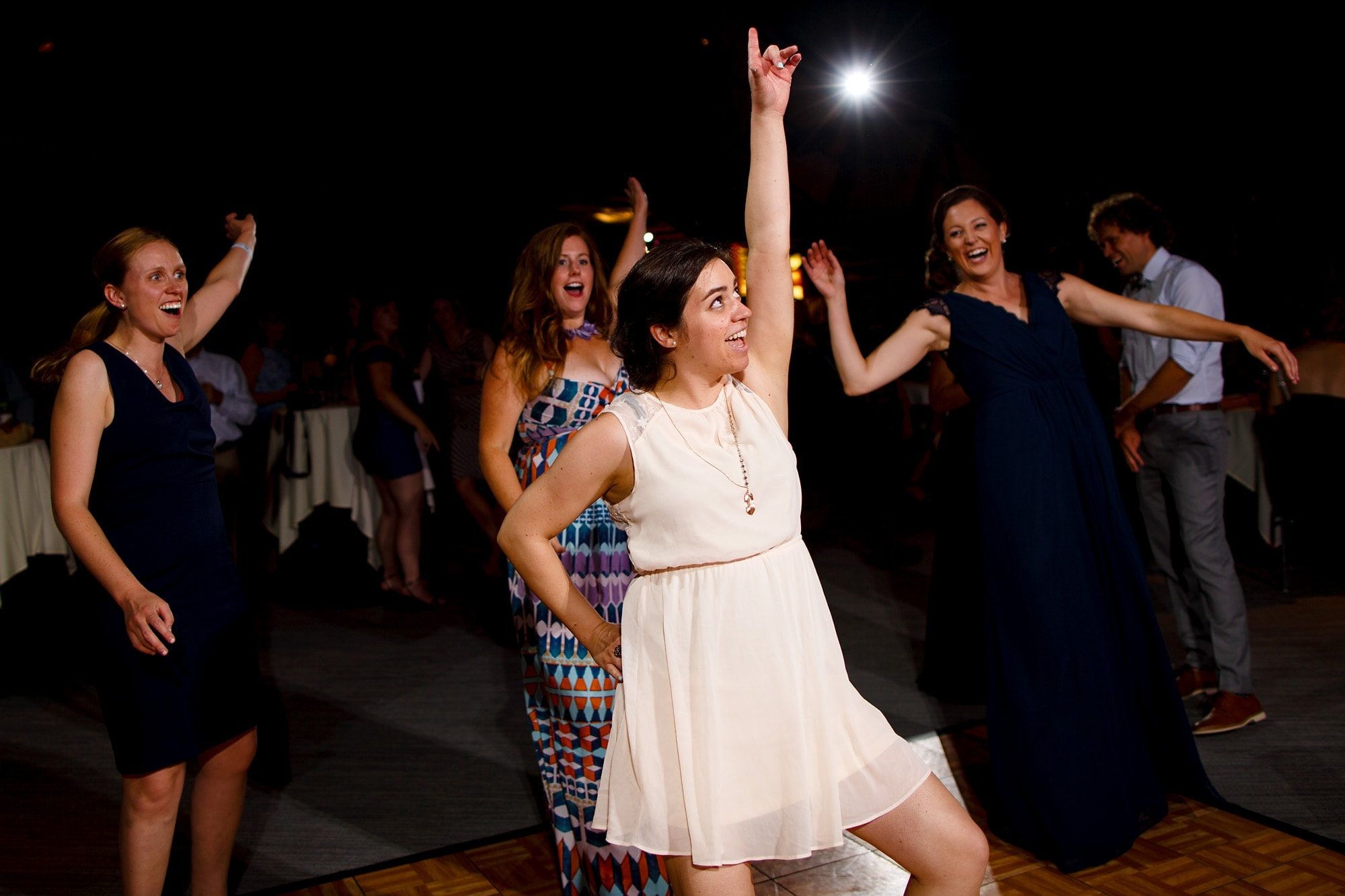 Guests dance at the reception