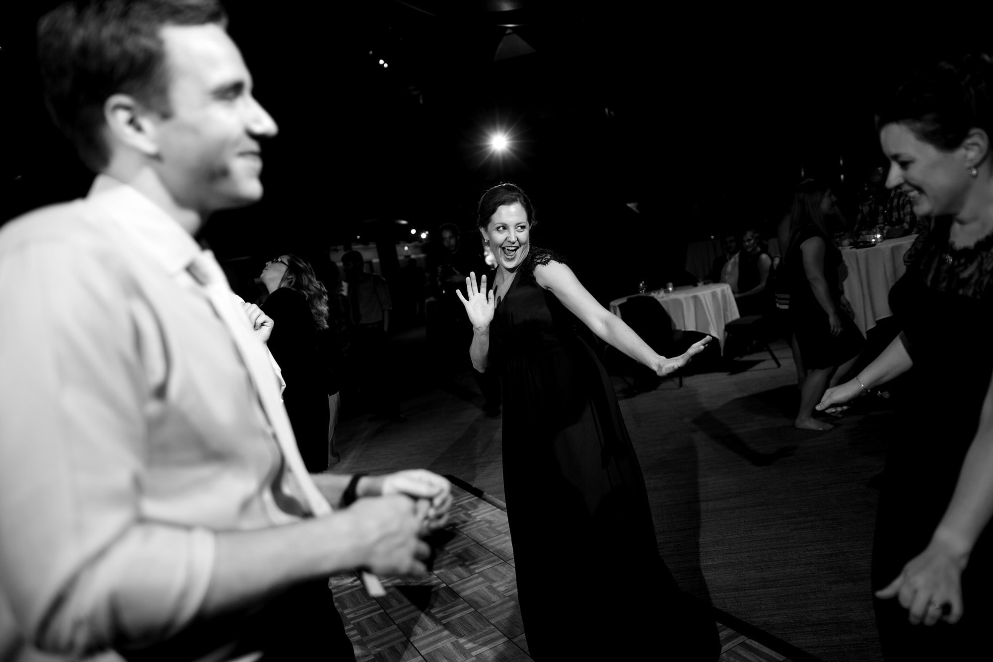 Guests dance at the reception at the Denver Museum of Nature and Science