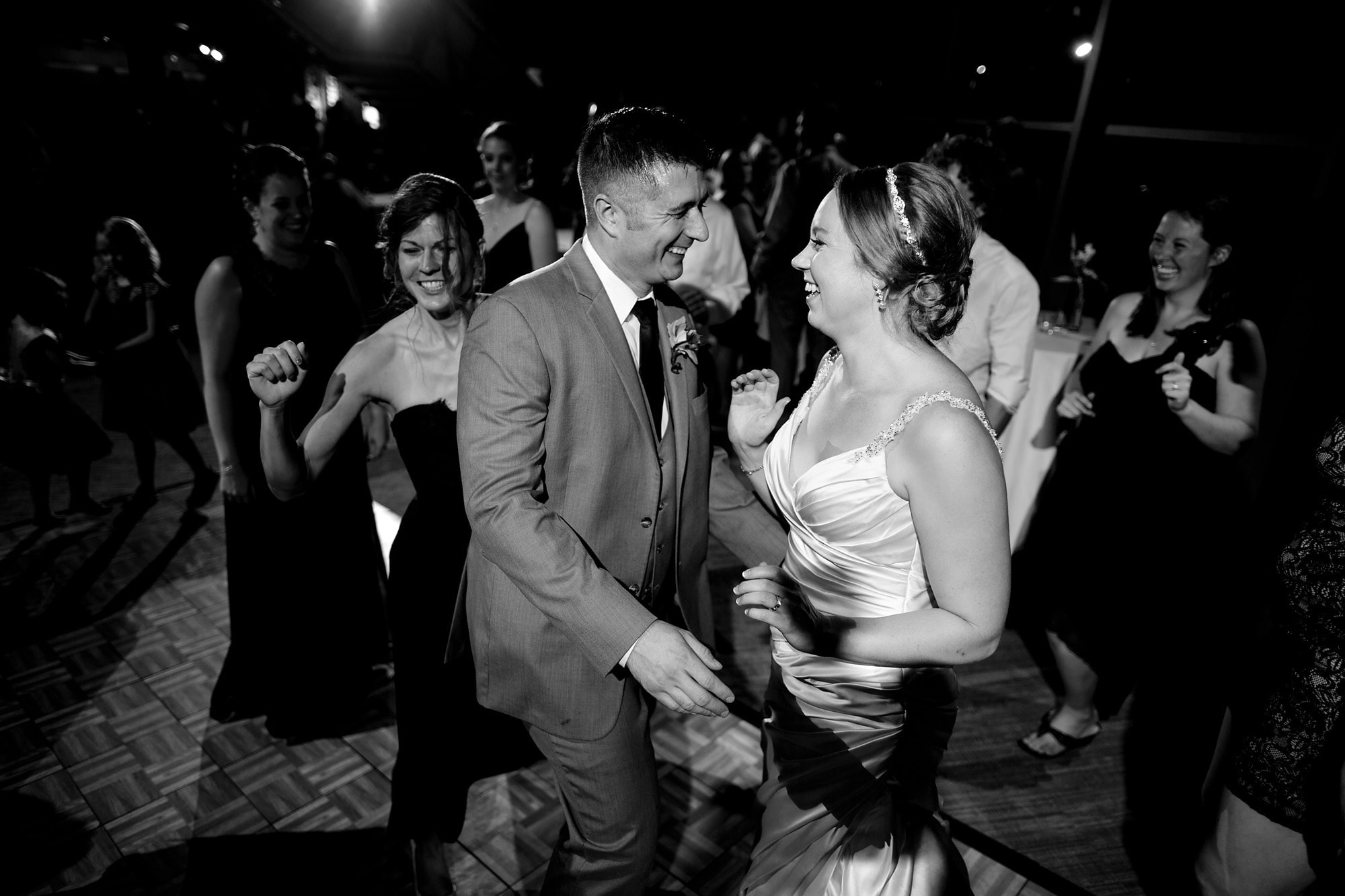 The bride and groom dance together in the west atrium of the Denver Museum of Nature and Science during their wedding