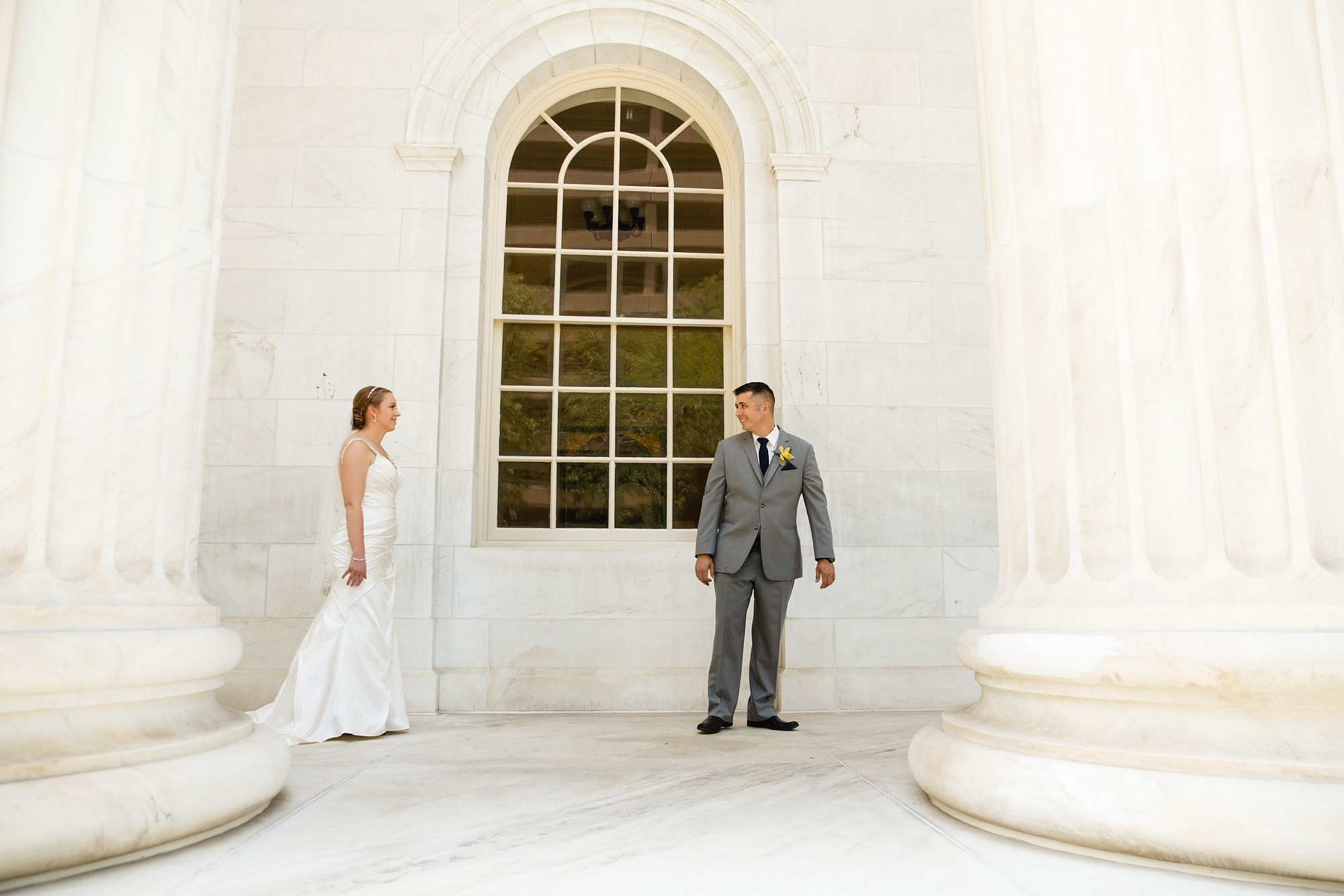 The bride and groom see each other during a first look at the courthouse in Denver