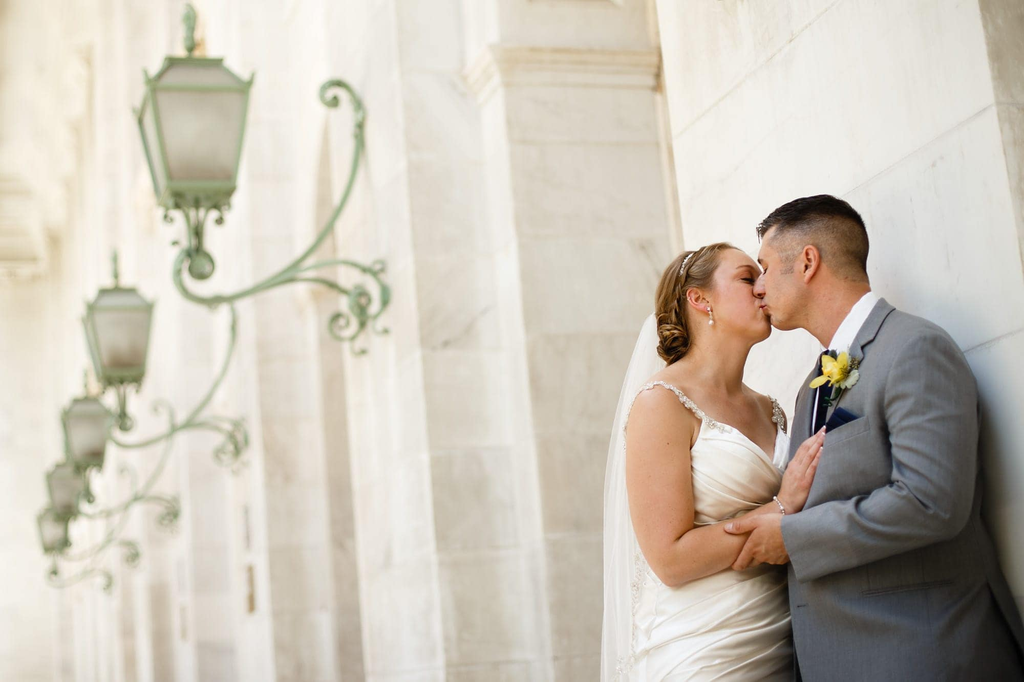 A couple kiss outside of the courthouse in Denver