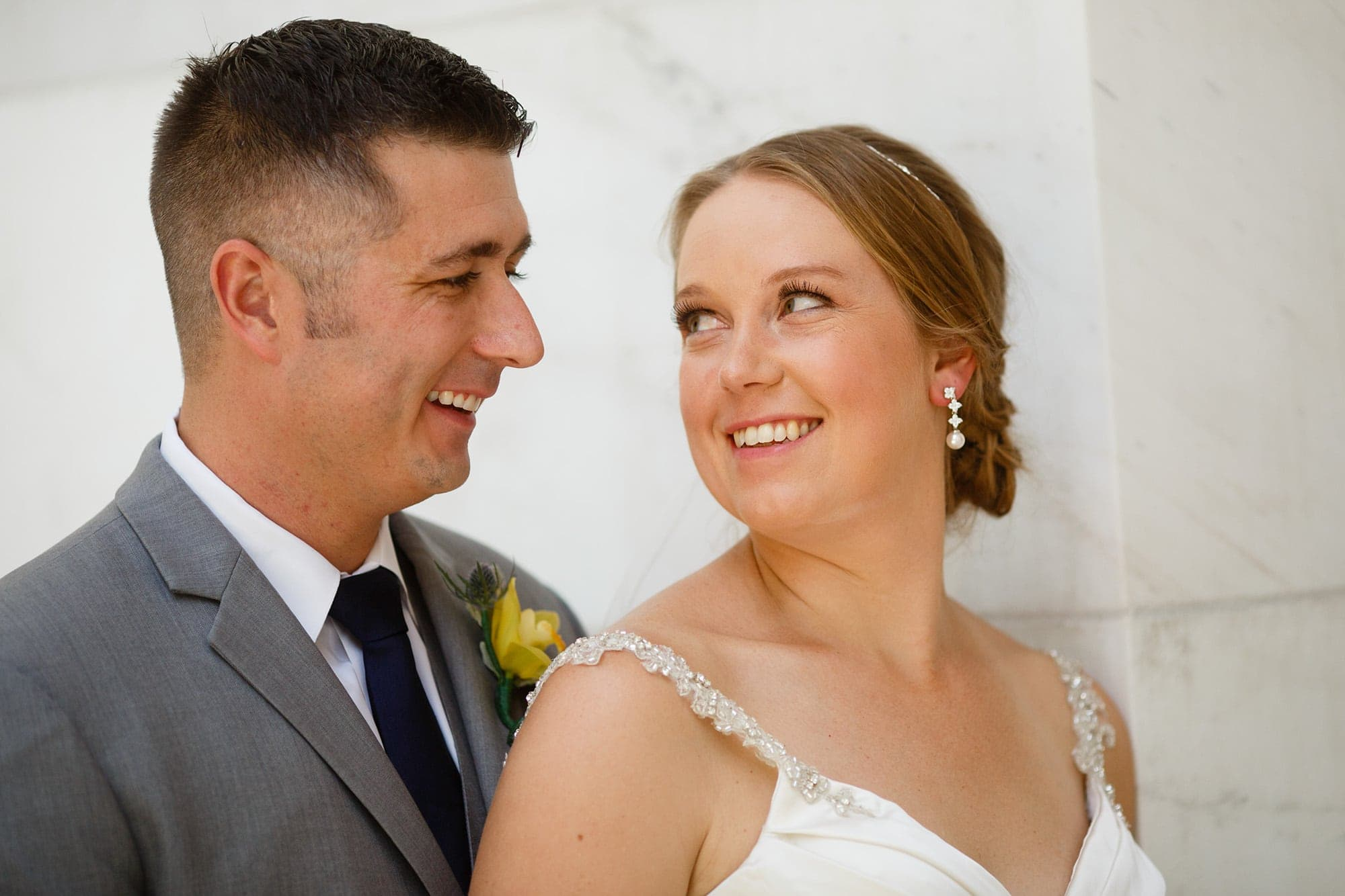 A couple look into each other's eyes in Denver, Colorado on their wedding day