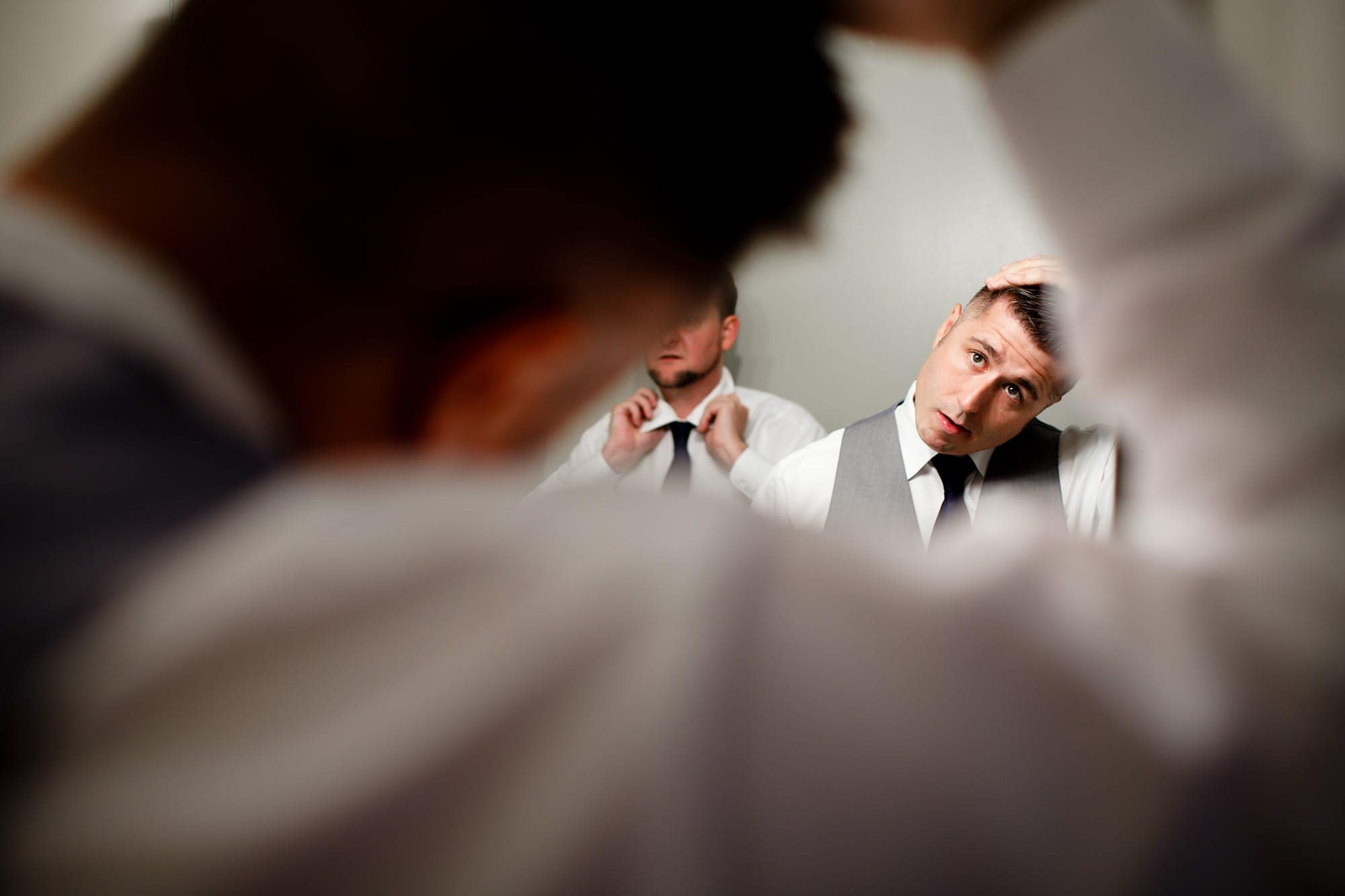 groom does his hair while getting ready