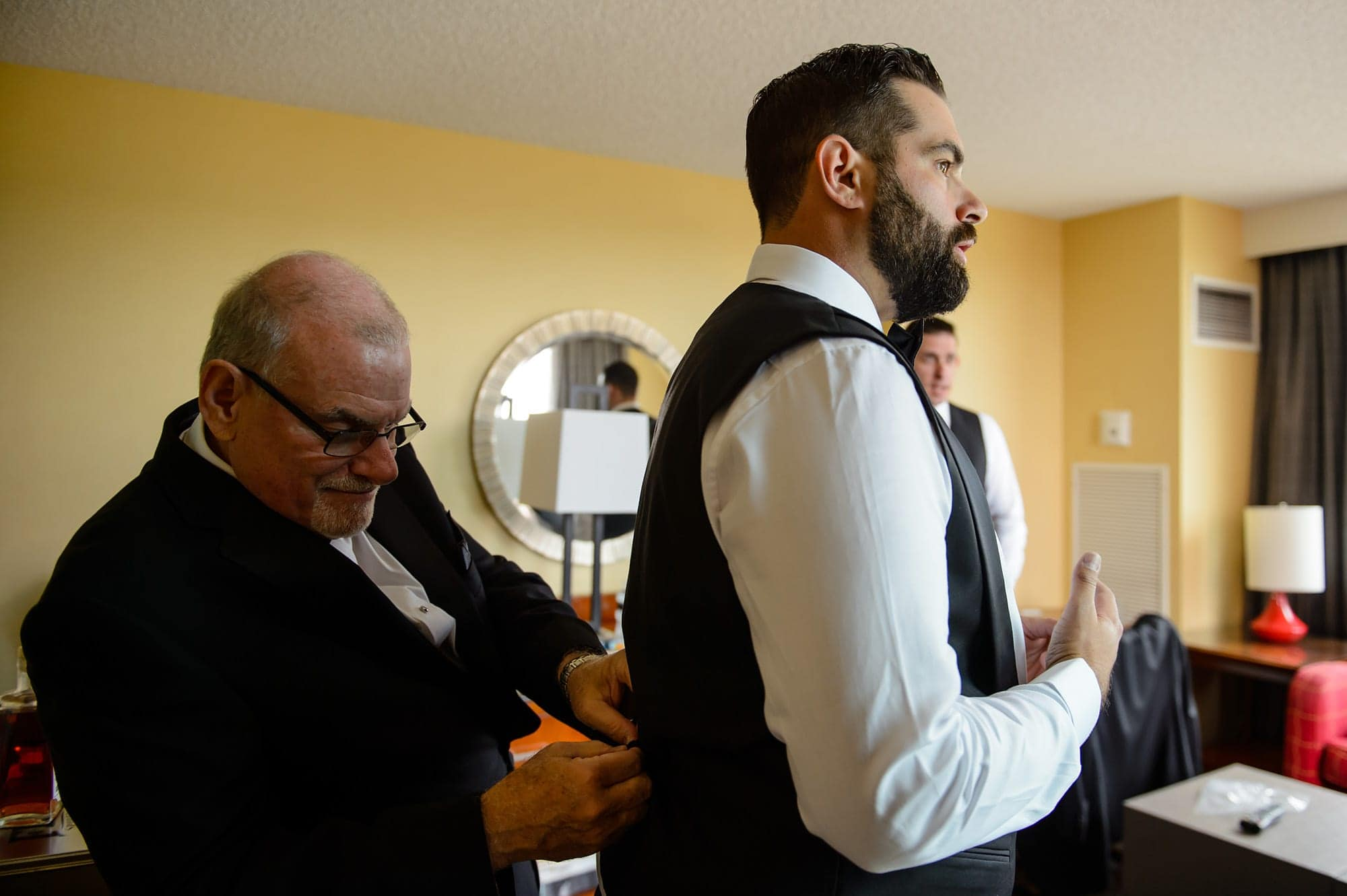Joshua gets ready with his father in their Colorado Springs Marriott
