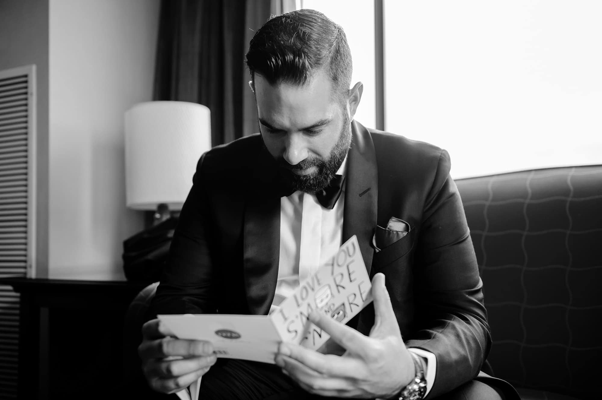 Joshua reads a personal note from his future bride in the hotel room