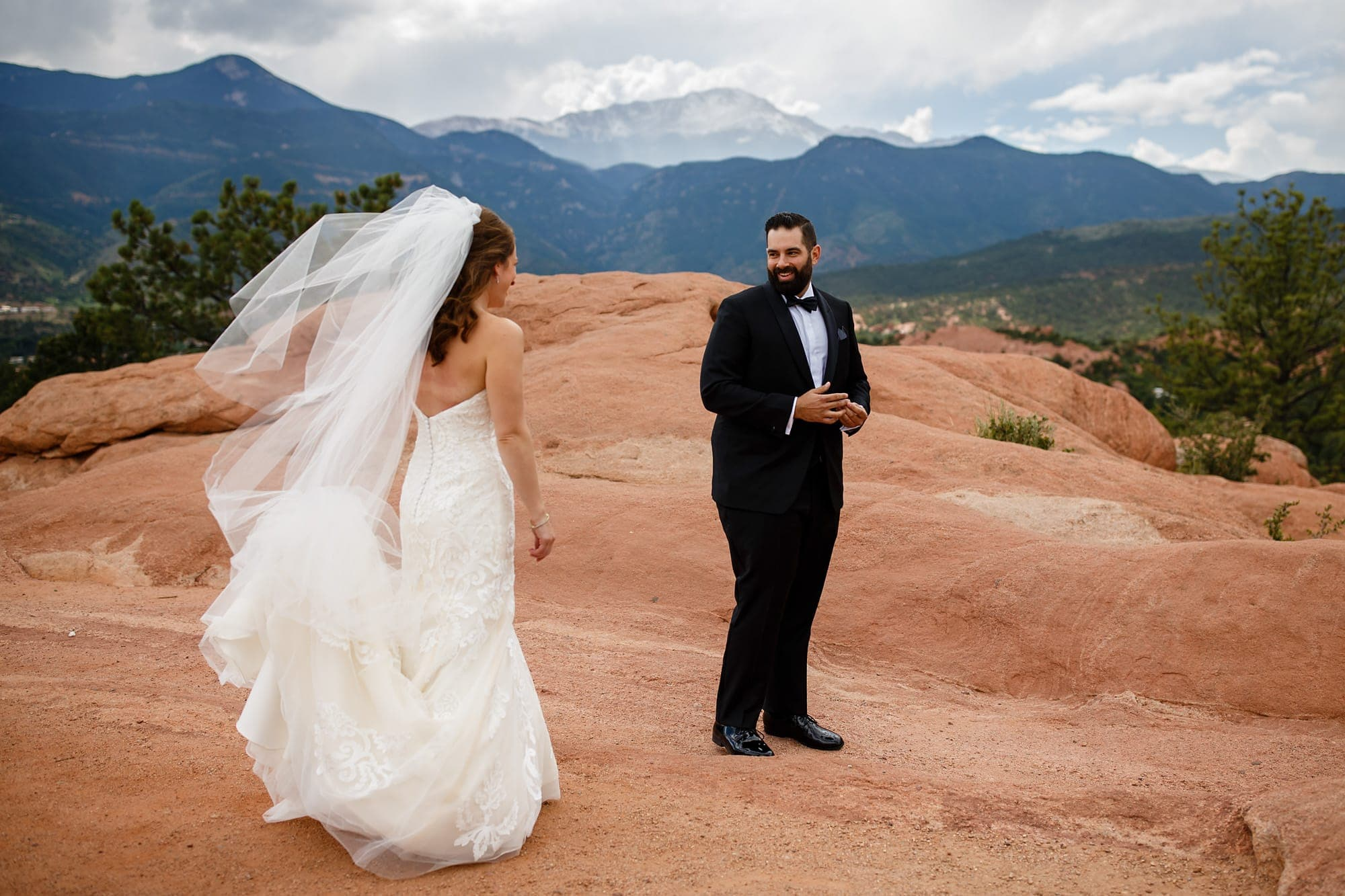 Joshua and Devan shaire thier first look in Garden of the Gods park near Pikes Peak in Colorado Springs