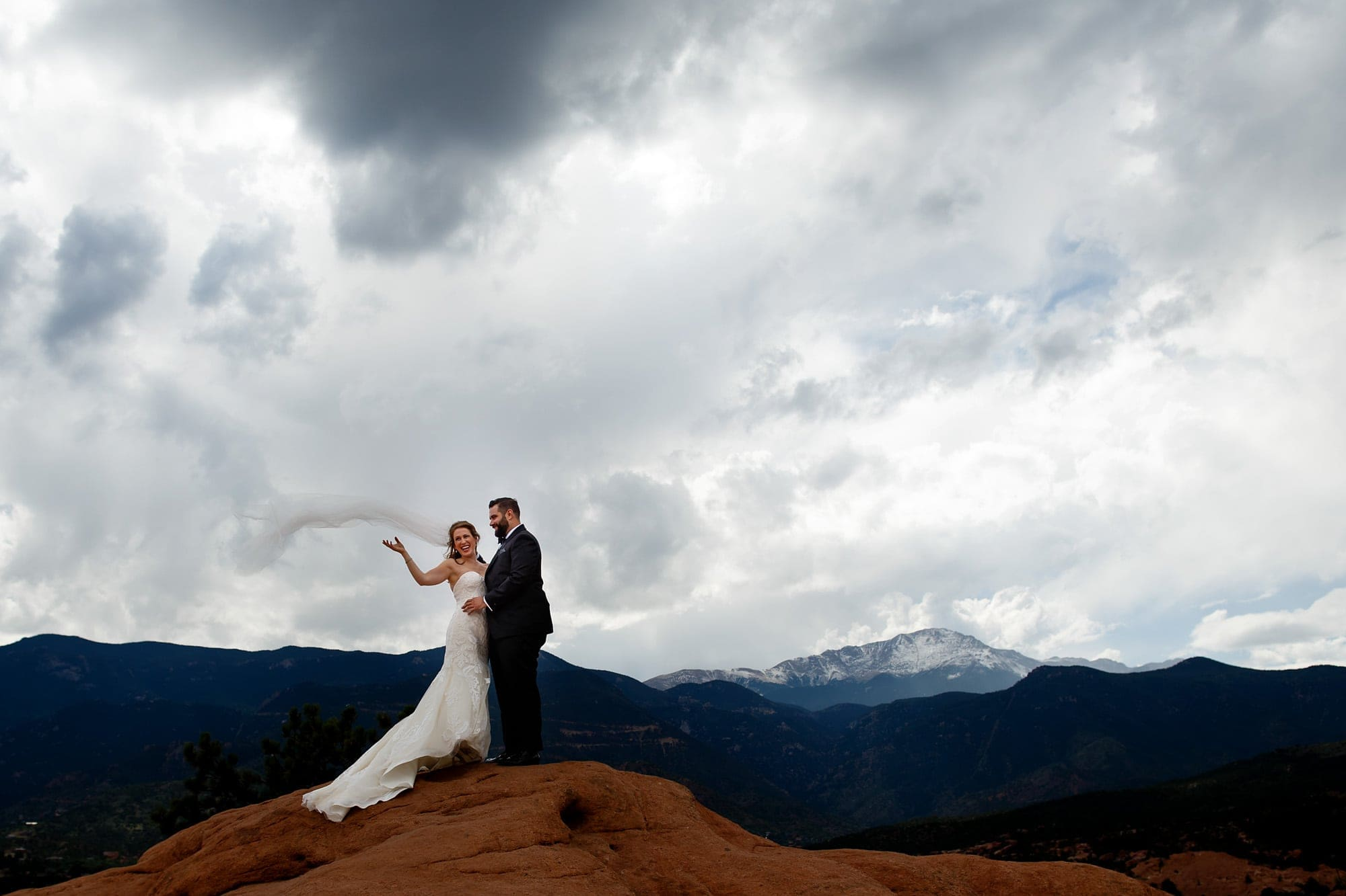 The bride's viel blows in the wind at Garden of the Gods park near Pikes Peak in Colorado Springs