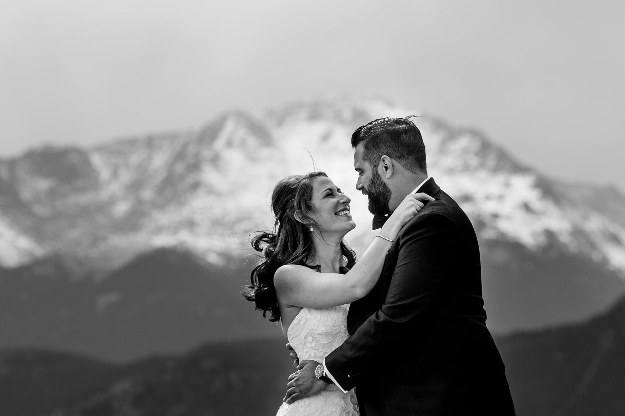 Devan and Joshua stand in front of Pikes Peak in Colorado Springs during a portrait before their wedding