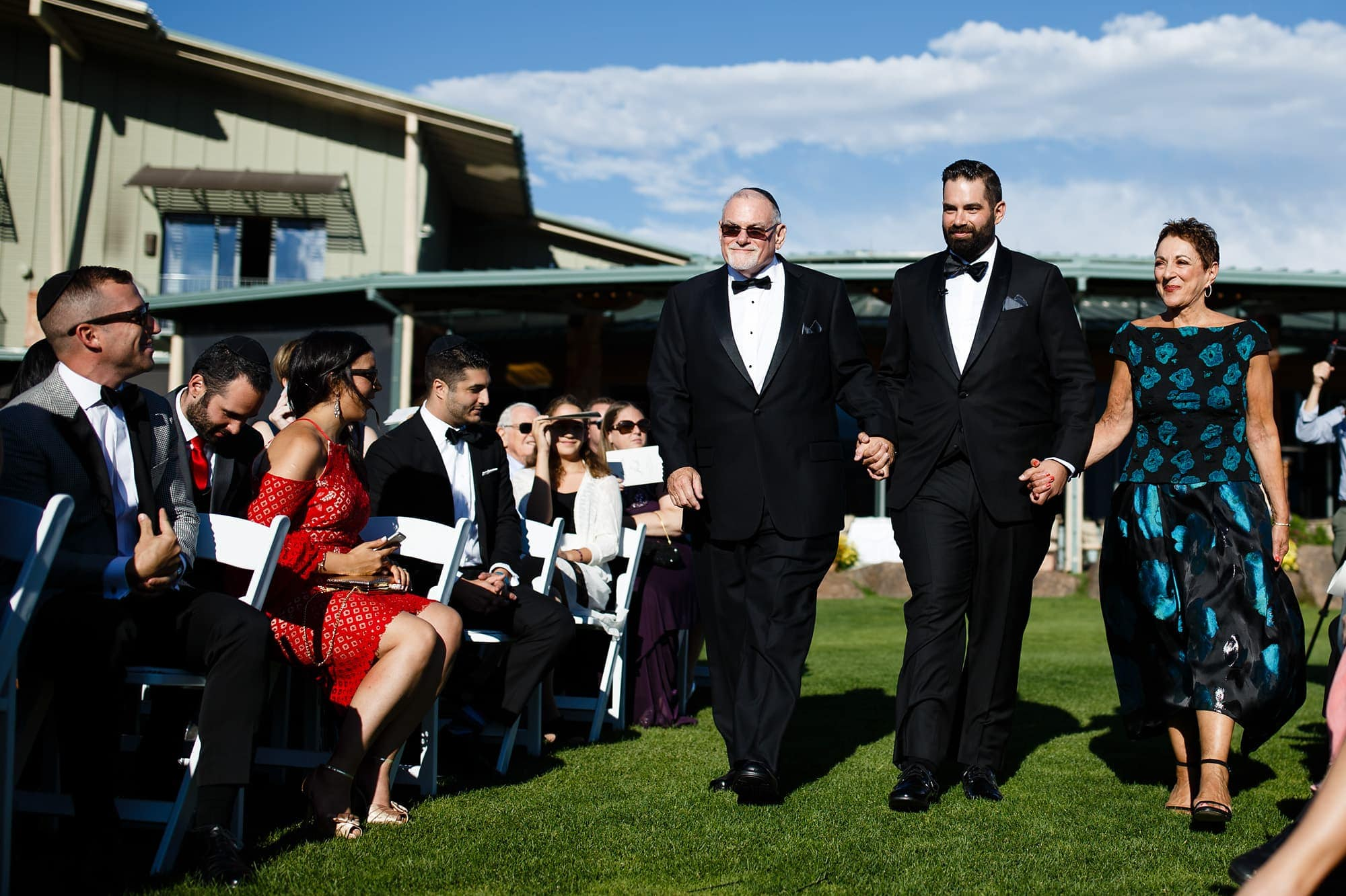 Joshua walks out with his parents during the wedding ceremony