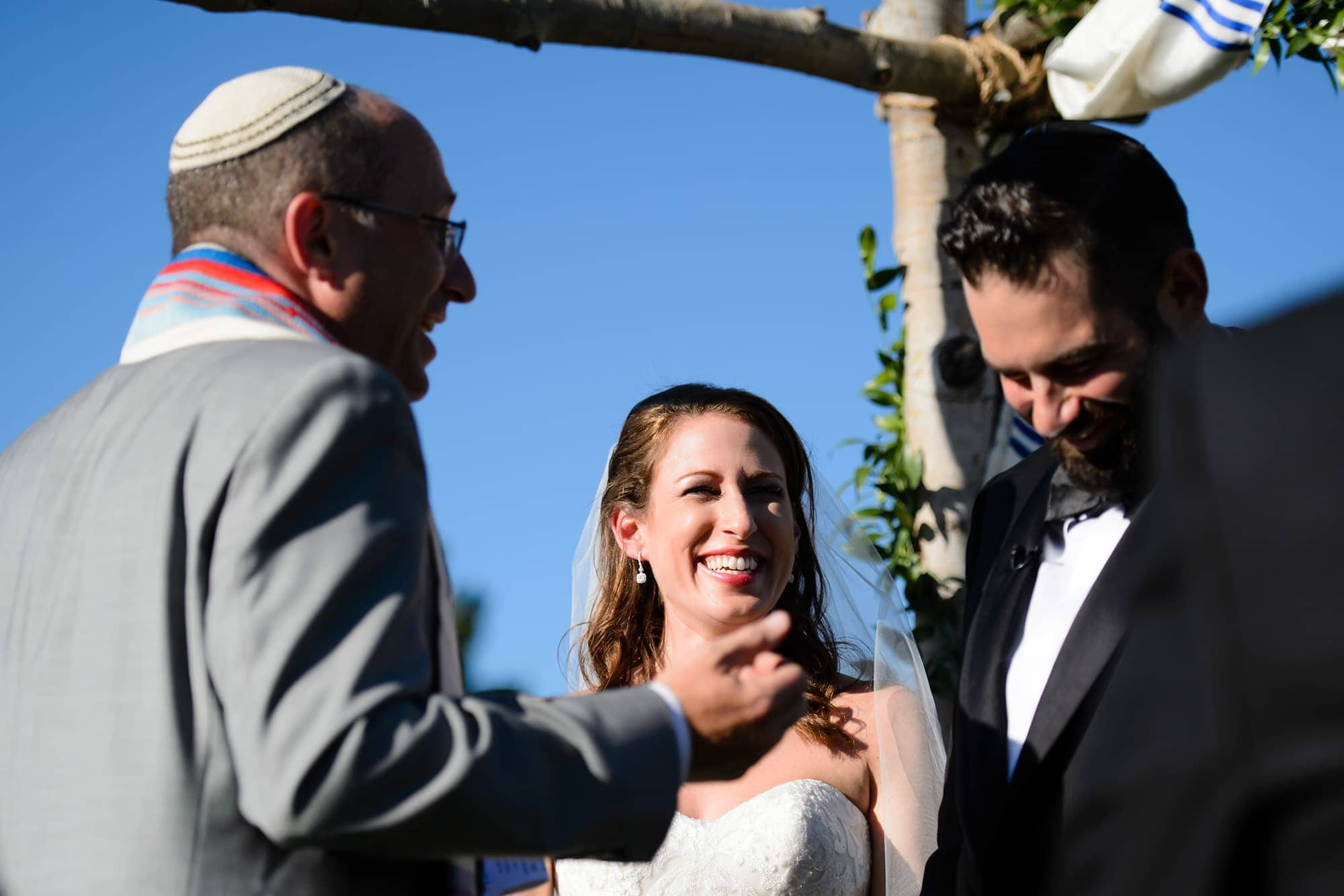 The Bride and Groom share a laugh during the ceremony