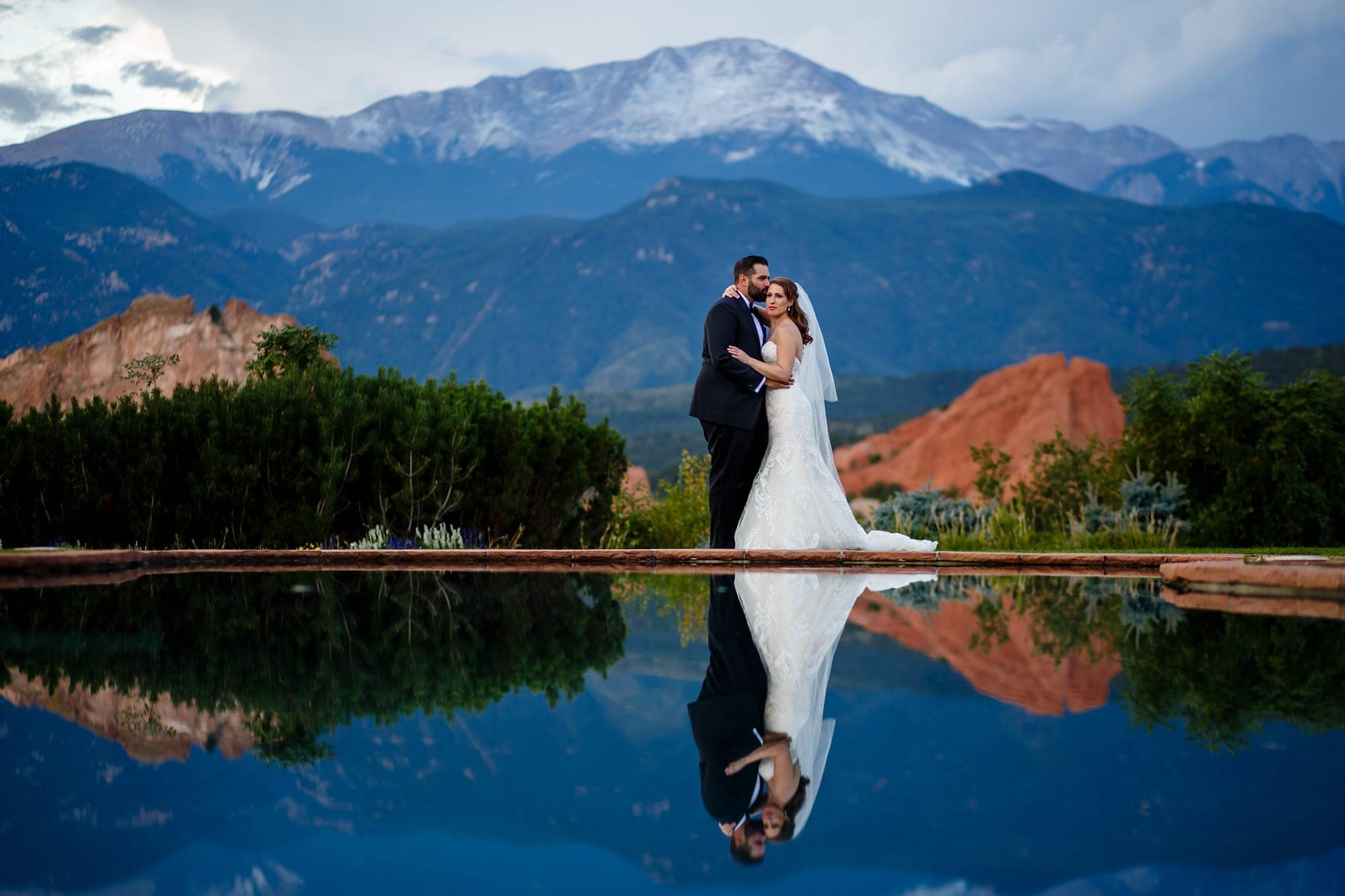 Reflected By The Pool Devan And Joshua Share A Moment Together As Pikes Peak Provides Backdrop After Their Wedding At Garden Of S Club