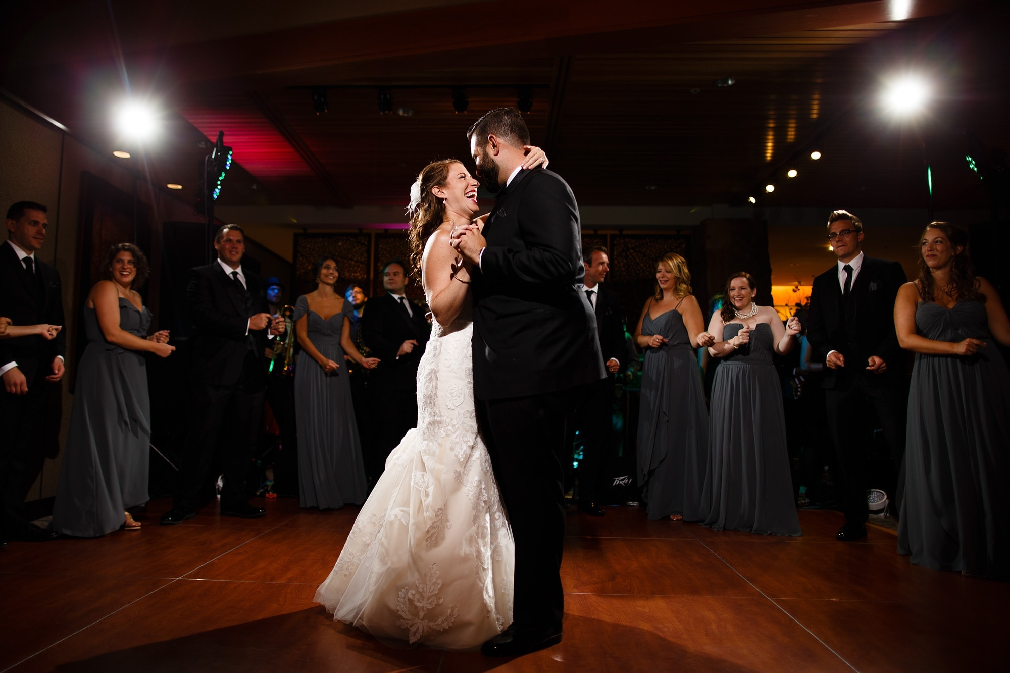 Devan and Joshua laugh during their first dance at Garden of the Gods Club