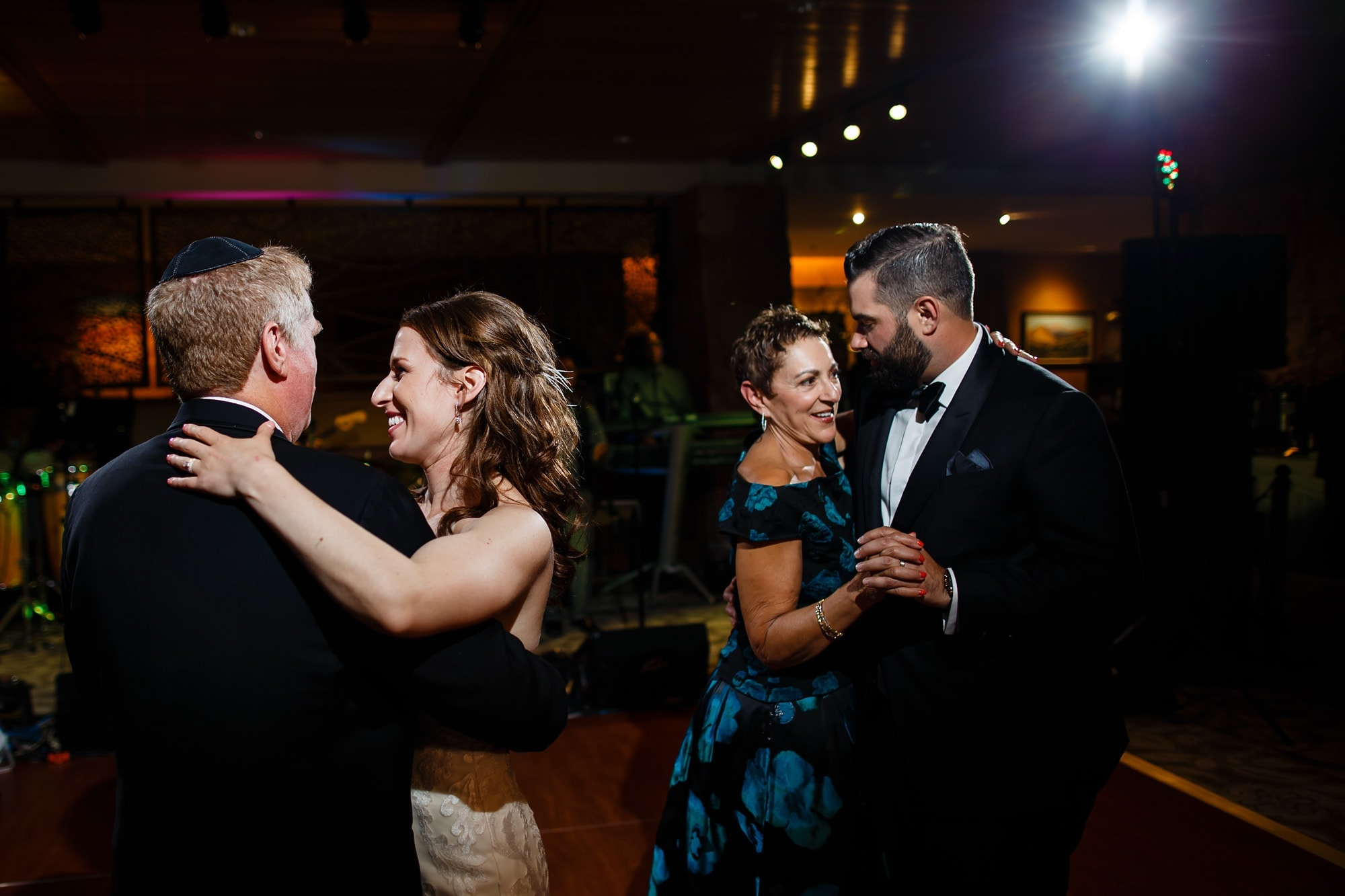 The bride and groom dance with their parents at Garden of the Gods Club